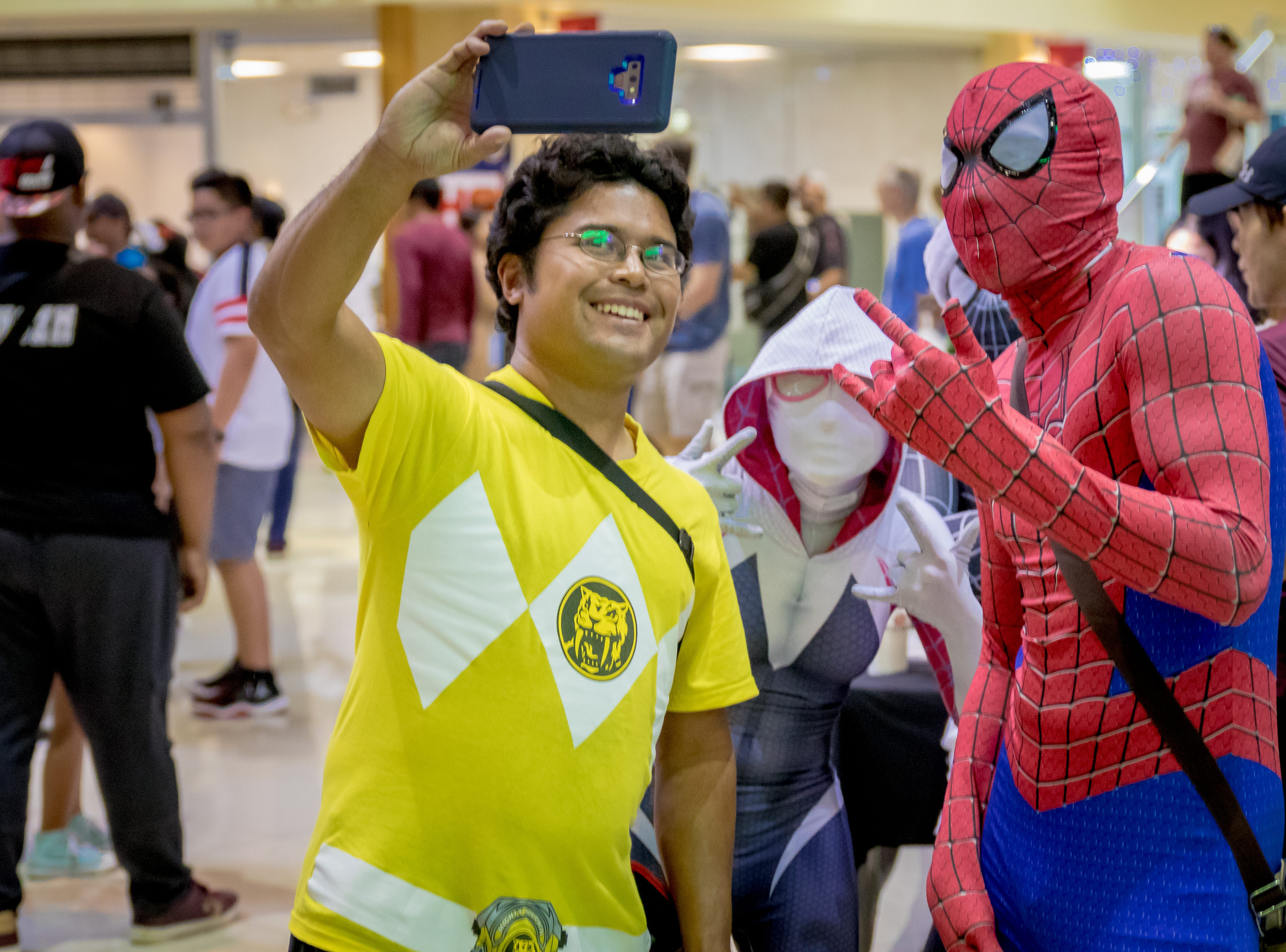 Attendees take self portrait with cosplayers during the Herocon event held at Agana Shopping Center on Dec. 9.