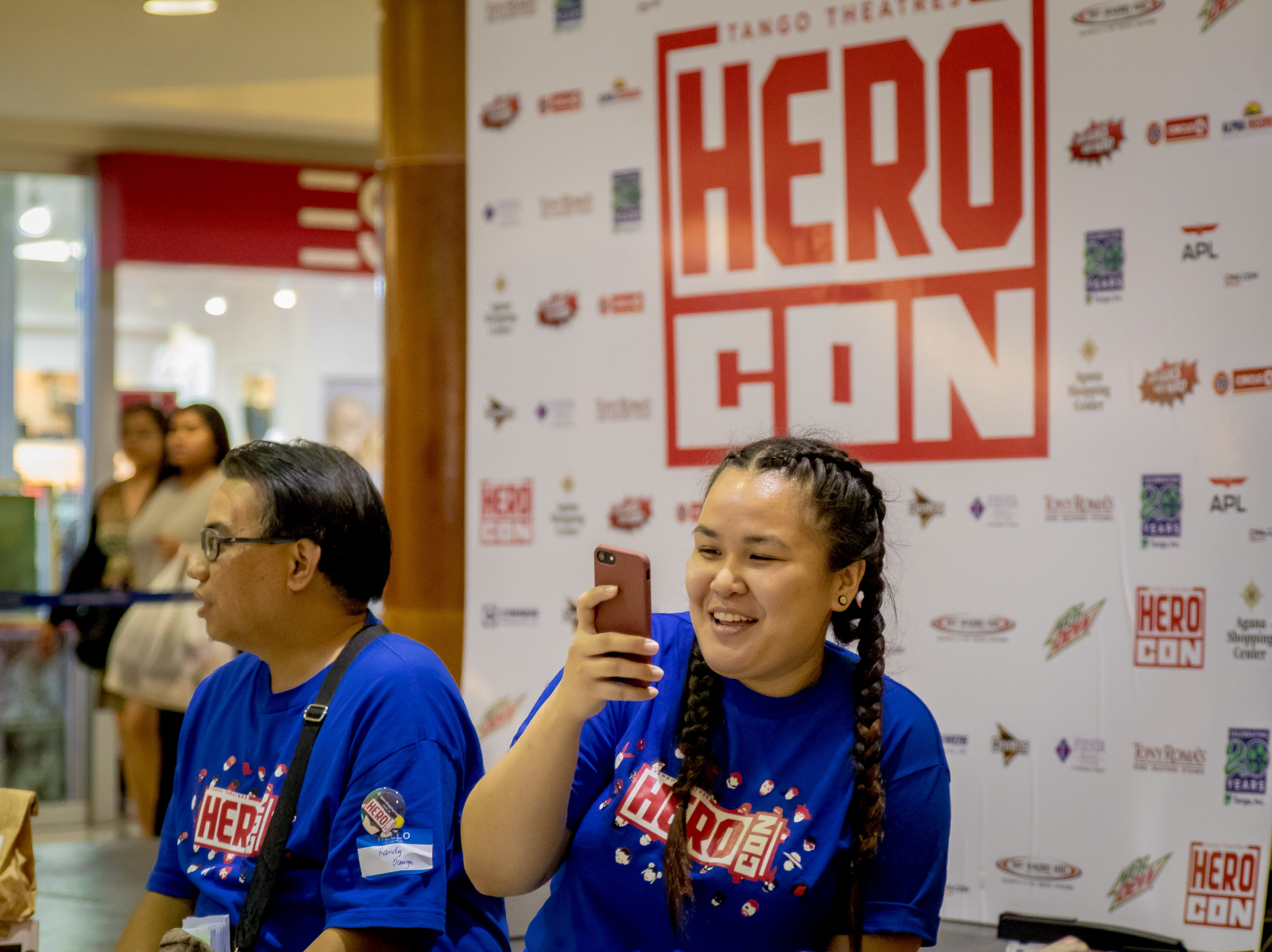 Attendees get excited as they see various cosplayers during the Herocon event held at Agana Shopping Center on Dec. 9.