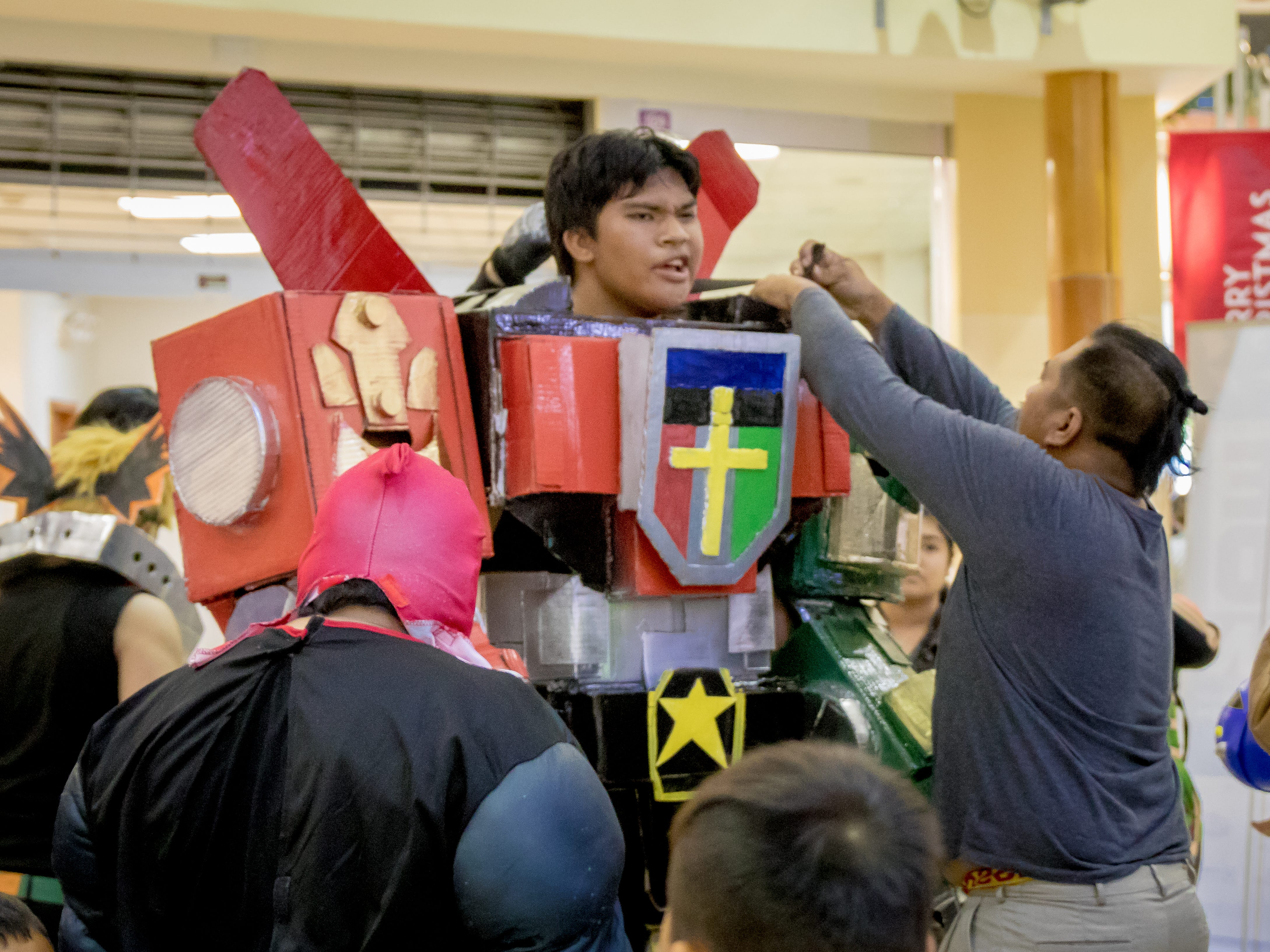 Cosplayers gets help dressing up during the Herocon event held at Agana Shopping Center on Dec. 9.