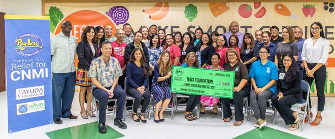 Pay-Less Community Foundation donates $30k for CNMI Typhoon Yutu Relief