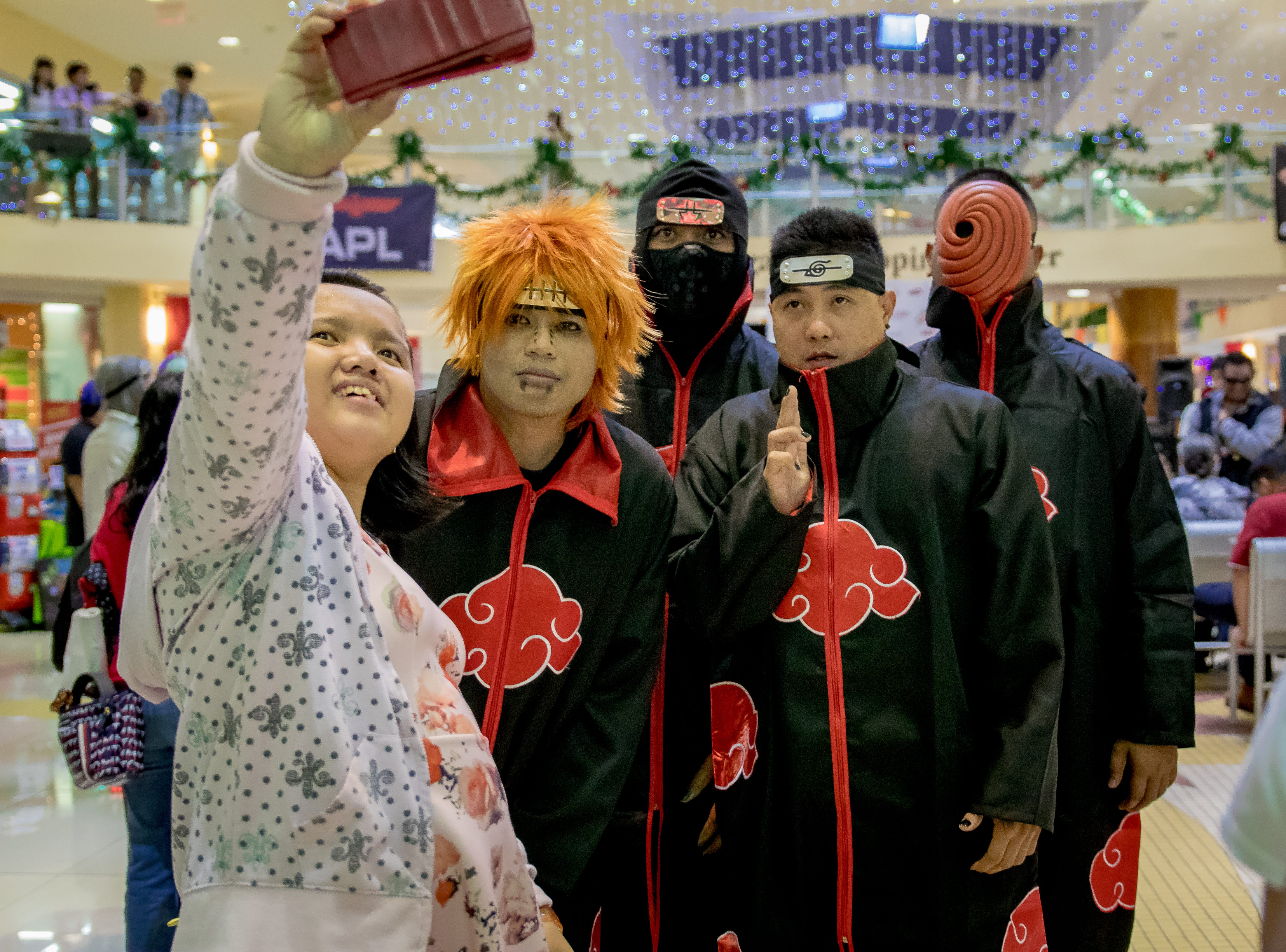 Aiko Sotomayor takes a self portrait with cosplayers during the Herocon event held at Agana Shopping Center on Dec. 9.