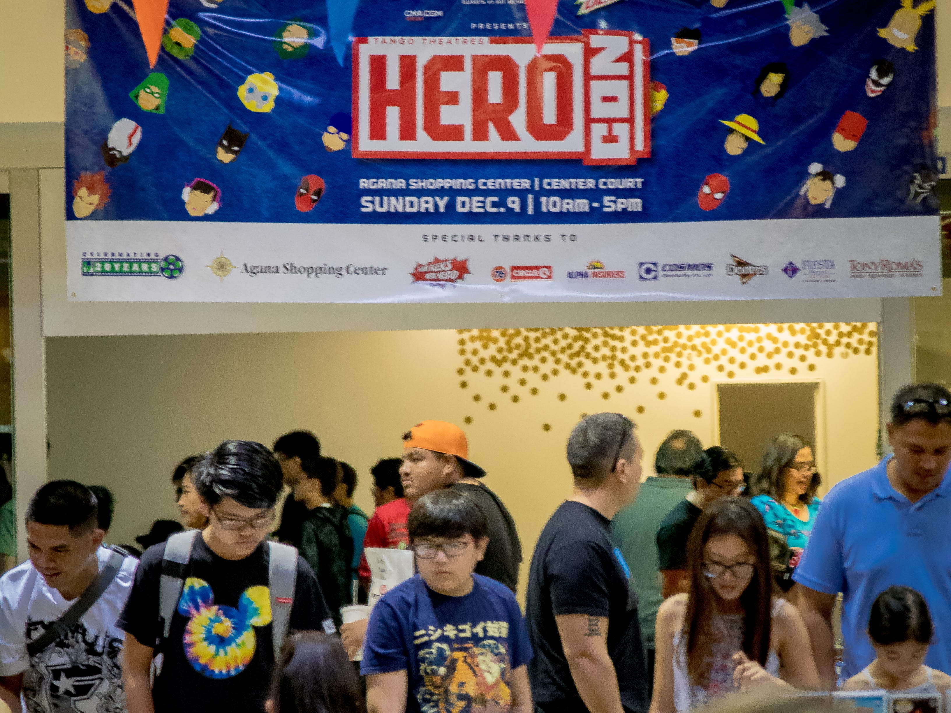 Mallgoers check out the various booths on display at the first Herocon held at Agana Shopping Center on Dec. 9.