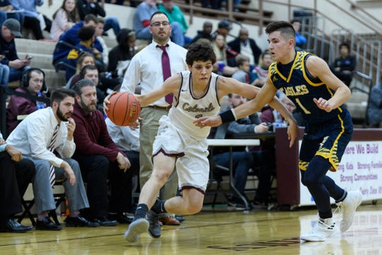Henderson County's Corey Stewart drives to the basketball as he is guarded by Day School's Ethan Hancock during Saturday's Independence Bank Classic at Henderson County High School in Henderson, Ky. The Colonels defeated the Eagles 56-51.