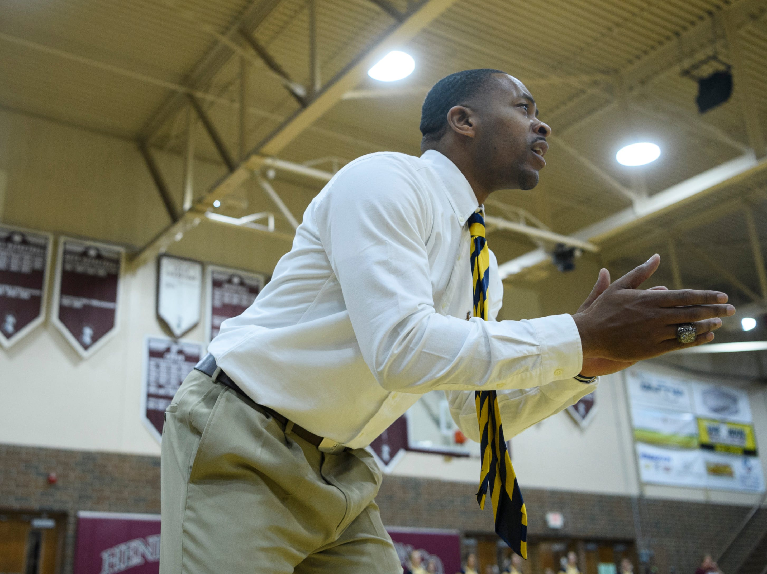Day School Head Coach Austin Brooks reacts as his team plays against the Henderson Colonels in the Independence Bank Classic at Henderson High School in Henderson, Ky., Saturday, Dec. 8, 2018. The Colonels defeated the Eagles 56-51.