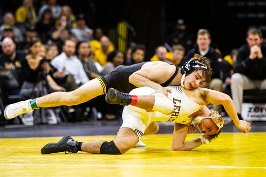 Iowa's Austin DeSanto, left, scores a takedown on Lehigh's Brandon Paetzell at 133 during a NCAA wrestling dual on Saturday, Dec. 8, 2018, at Carver-Hawkeye Arena in Iowa City.