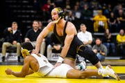 Iowa's Alex Marinelli, right, wrestles Lehigh's Trey Cornish at 165 during a NCAA wrestling dual on Saturday, Dec. 8, 2018, at Carver-Hawkeye Arena in Iowa City.