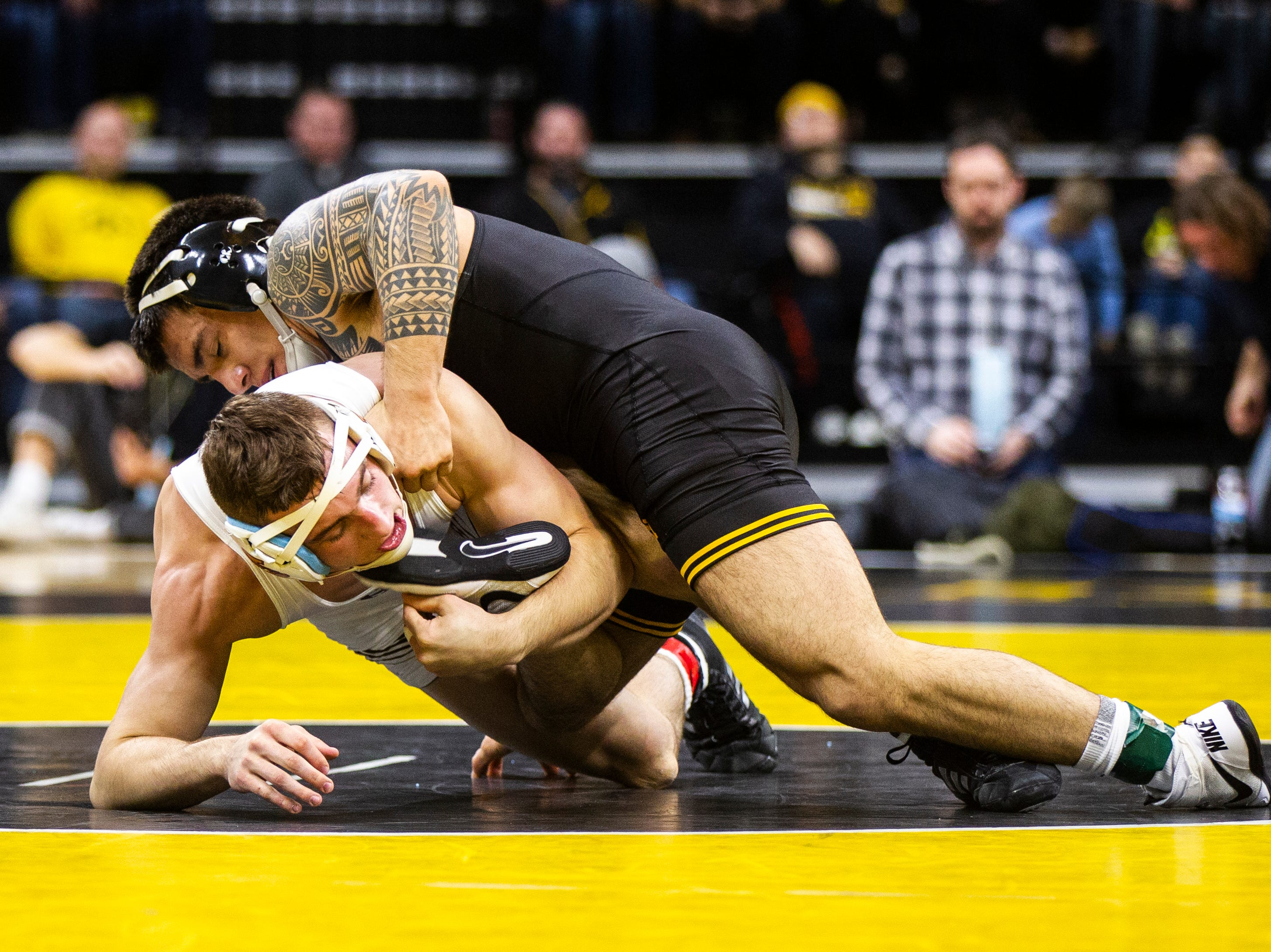 Iowa's Pat Lugo, right, wrestles Lehigh's Jimmy Hoffman at 149 during a NCAA wrestling dual on Saturday, Dec. 8, 2018, at Carver-Hawkeye Arena in Iowa City.