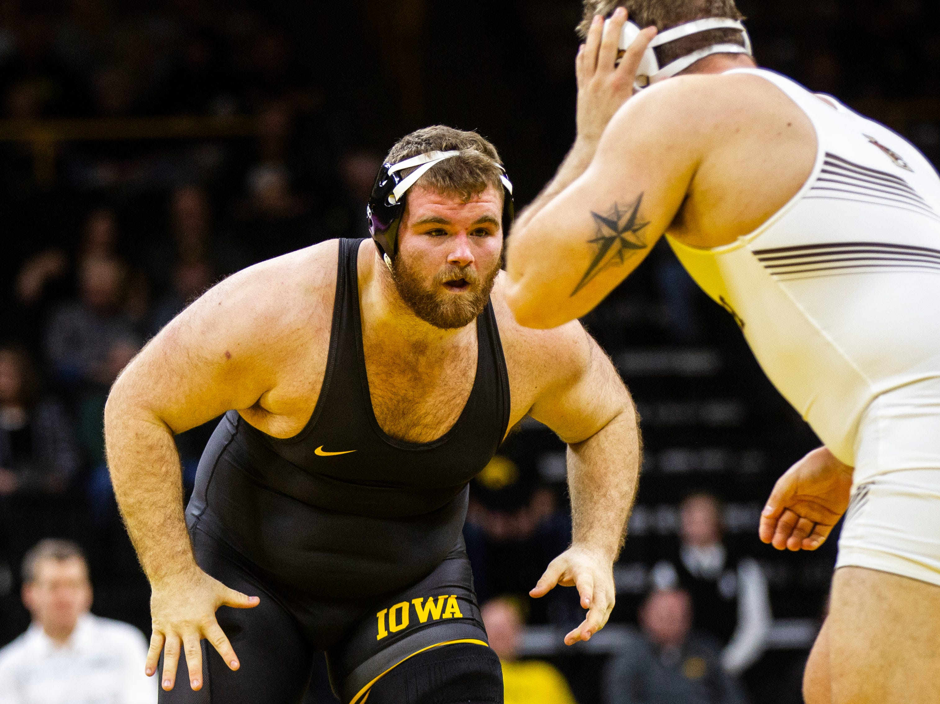 Iowa's Aaron Costello, left, wrestles Lehigh's Jordan Wood at 285 during a NCAA wrestling dual on Saturday, Dec. 8, 2018, at Carver-Hawkeye Arena in Iowa City.