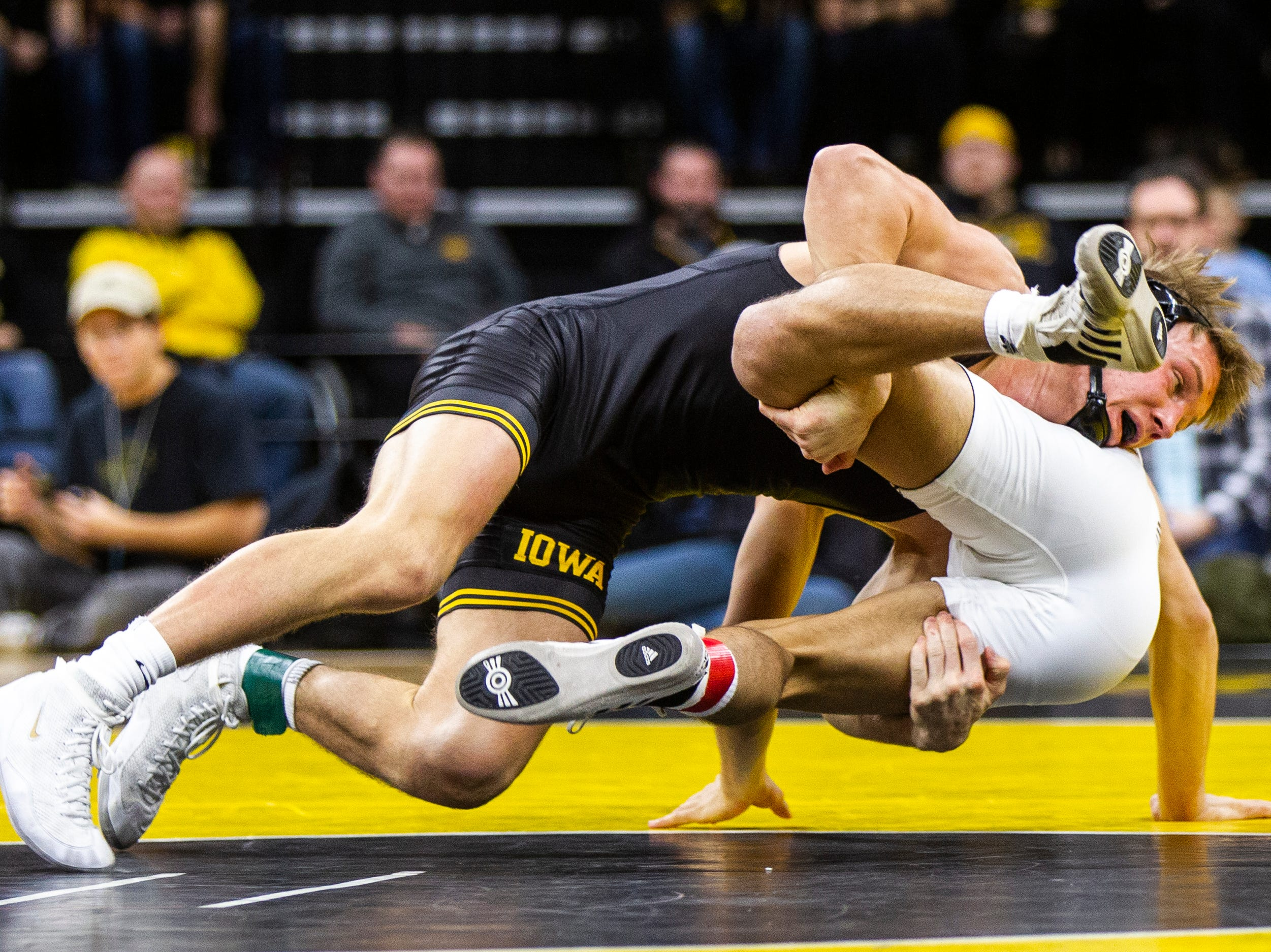 Iowa's Max Murin, left, gets a takedown on Lehigh's Ryan Pomrinca at 141 during a NCAA wrestling dual on Saturday, Dec. 8, 2018, at Carver-Hawkeye Arena in Iowa City.