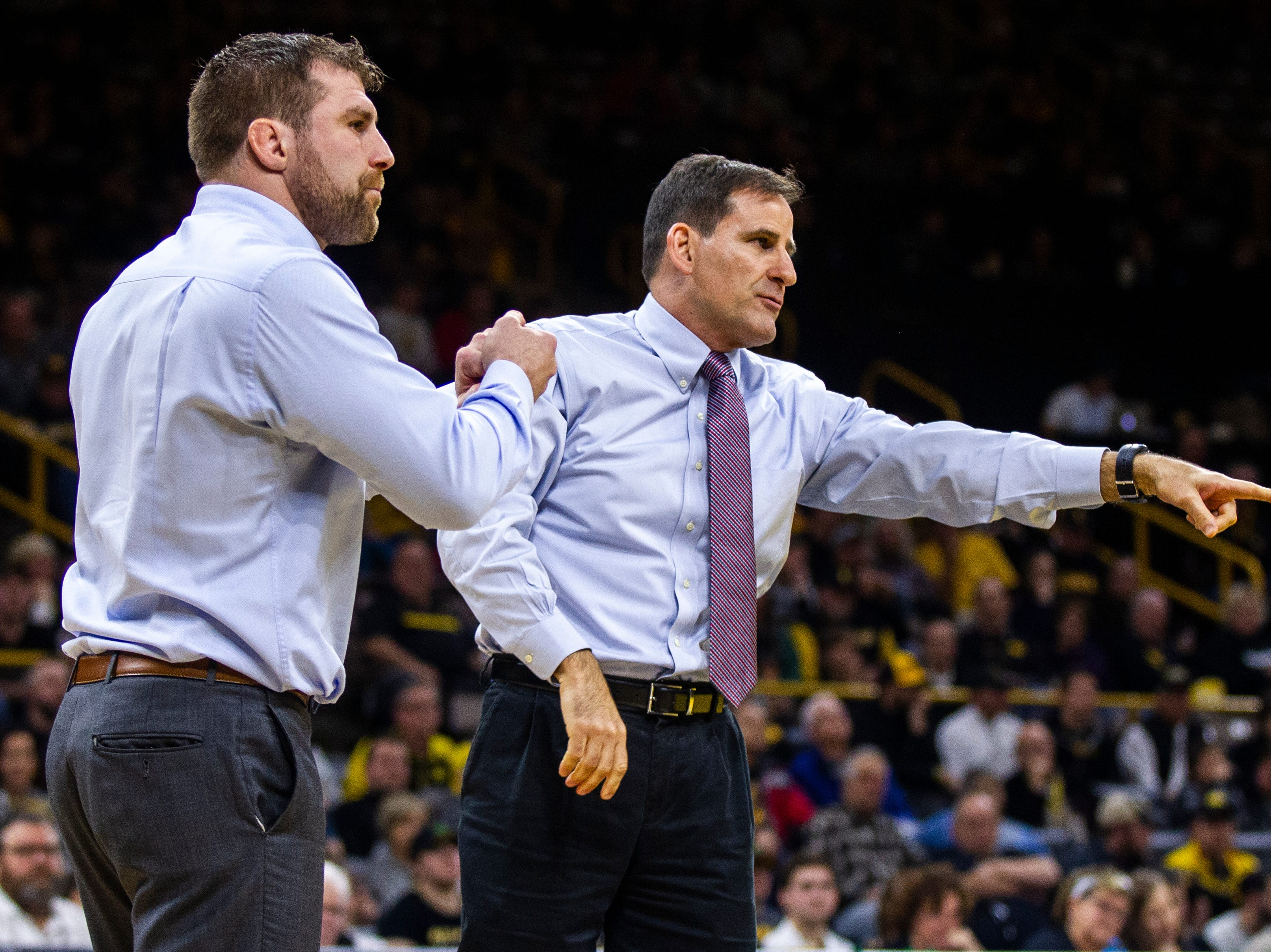 Lehigh head coach Pat Santoro, right, and volunteer assistant coach Zach Rey call a challenge during a NCAA wrestling dual on Saturday, Dec. 8, 2018, at Carver-Hawkeye Arena in Iowa City.