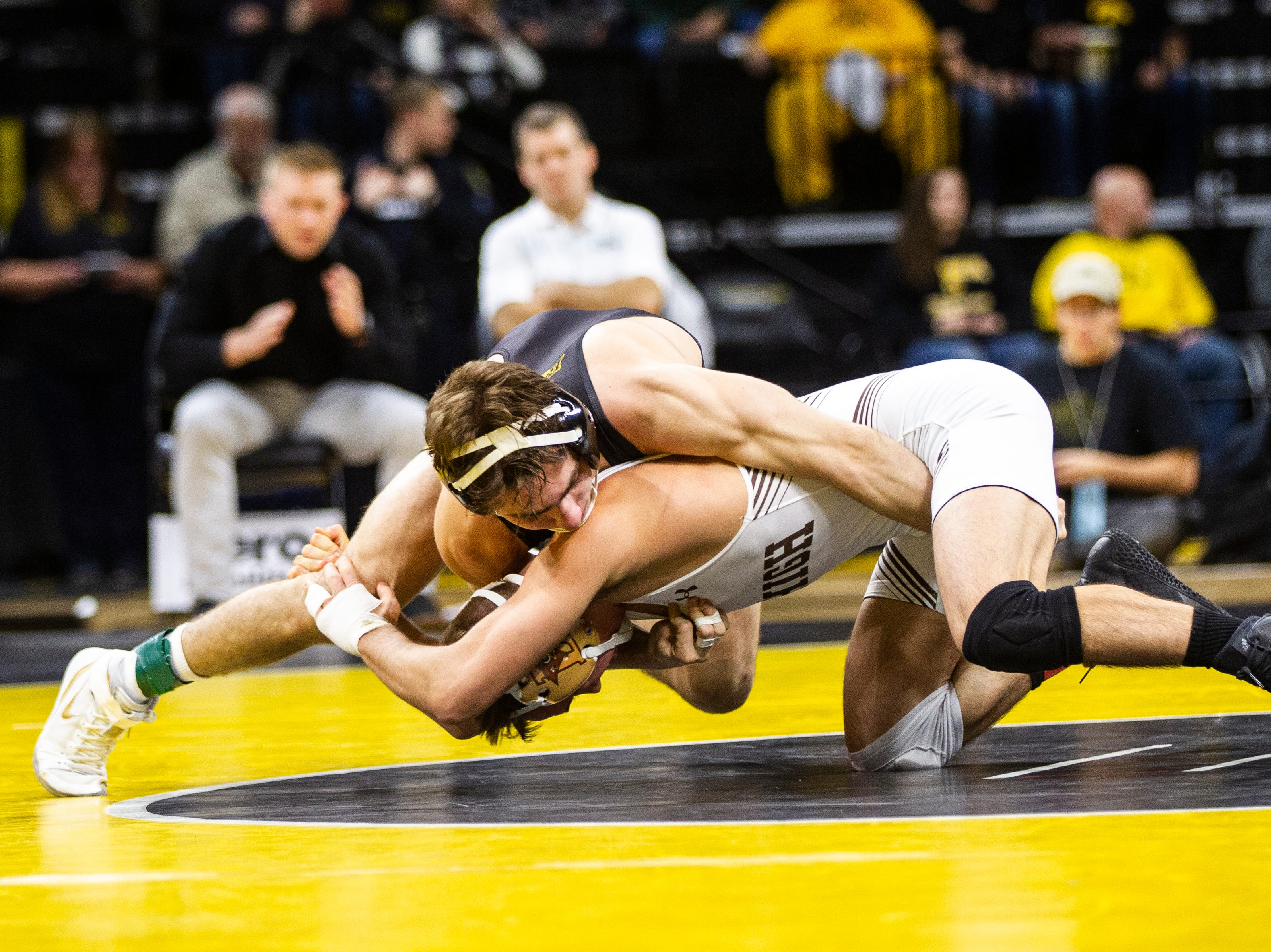 Iowa's Austin DeSanto, left, wrestles Lehigh's Brandon Paetzell at 133 during a NCAA wrestling dual on Saturday, Dec. 8, 2018, at Carver-Hawkeye Arena in Iowa City.
