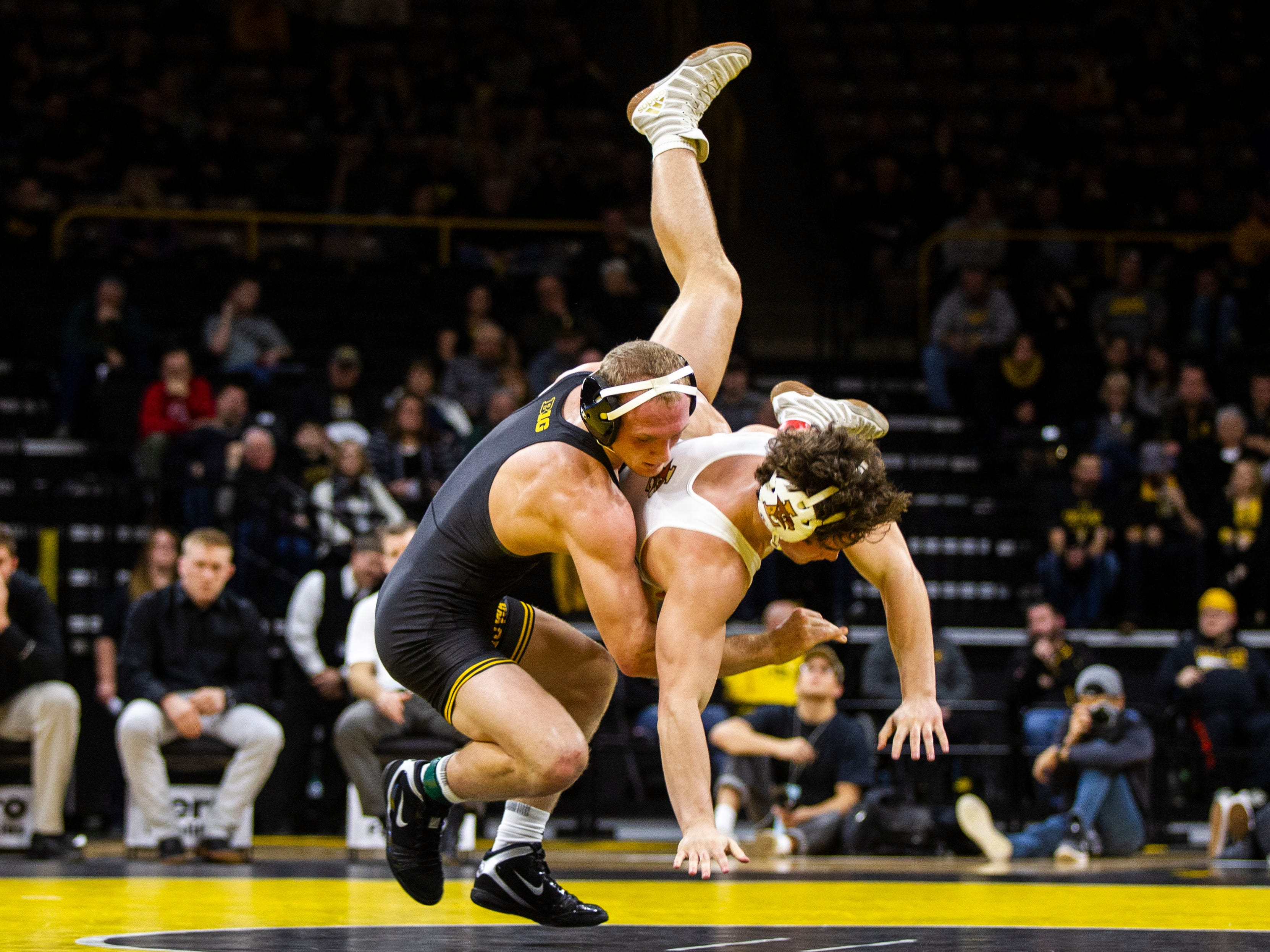Iowa's Kaleb Young, left, wrestles Lehigh's Josh Humphreys at 157 during a NCAA wrestling dual on Saturday, Dec. 8, 2018, at Carver-Hawkeye Arena in Iowa City.