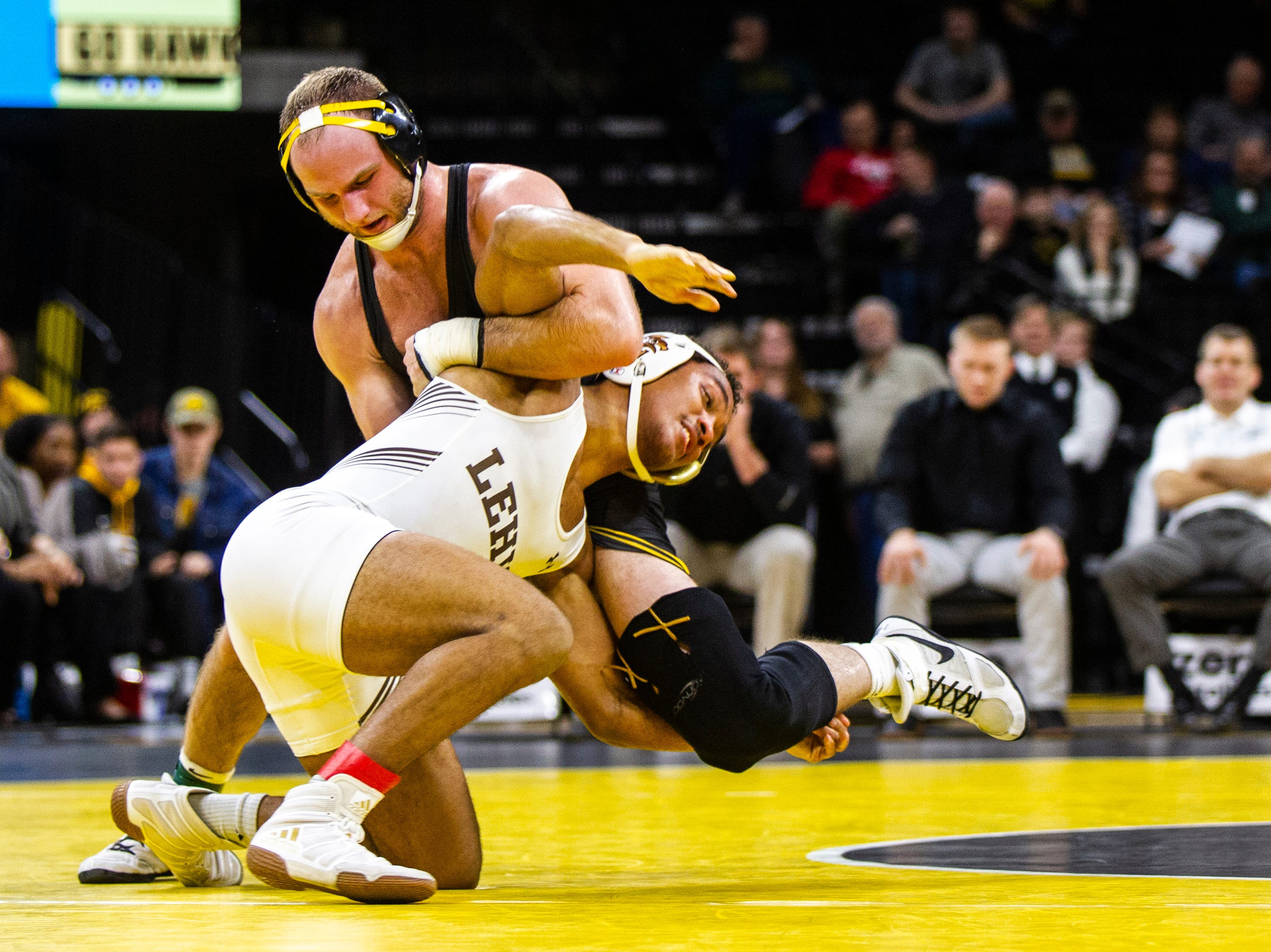 Iowa's Alex Marinelli, left, wrestles Lehigh's Trey Cornish at 165 during a NCAA wrestling dual on Saturday, Dec. 8, 2018, at Carver-Hawkeye Arena in Iowa City.