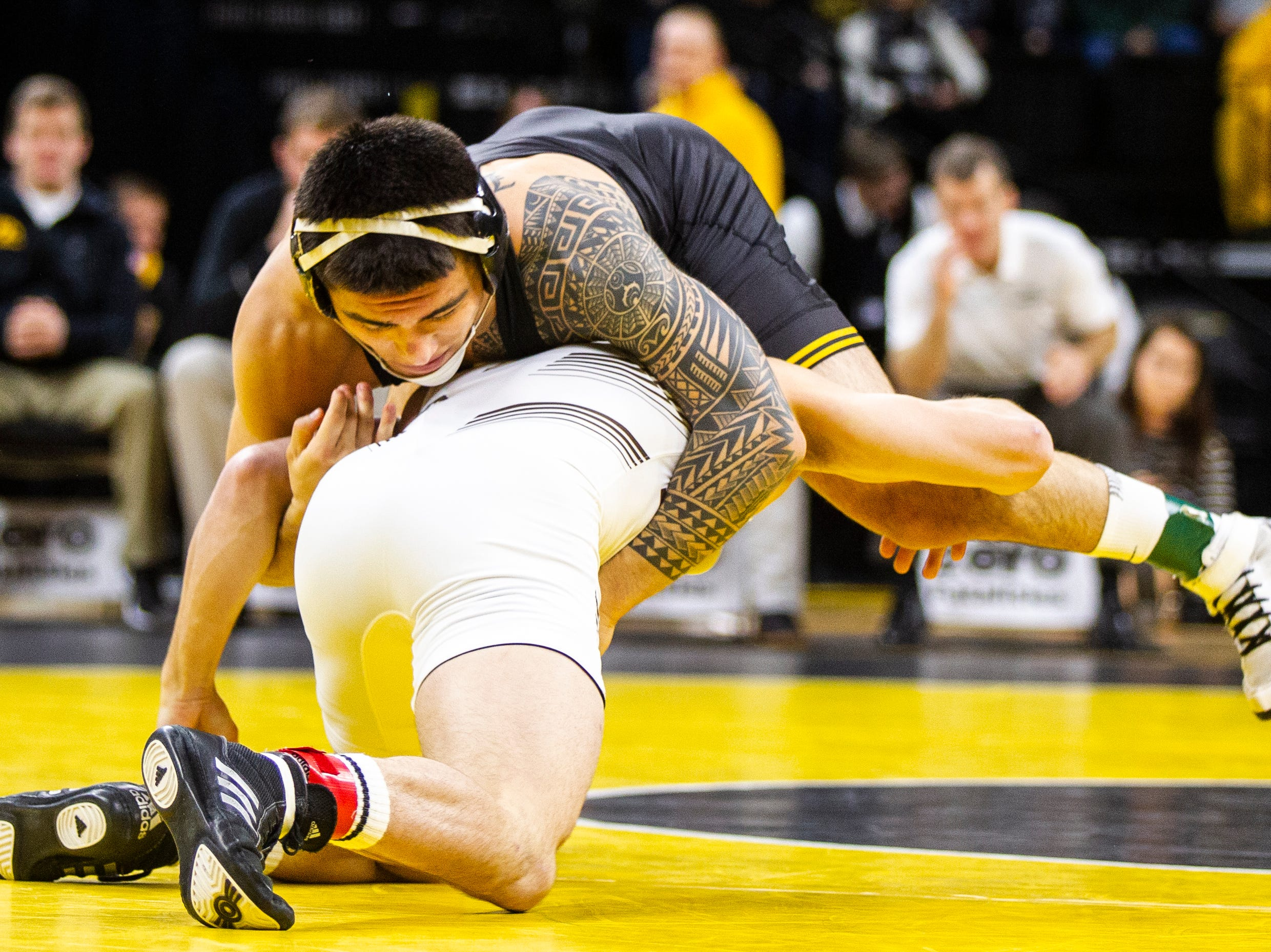 Iowa's Pat Lugo, top, wrestles Lehigh's Jimmy Hoffman at 149 during a NCAA wrestling dual on Saturday, Dec. 8, 2018, at Carver-Hawkeye Arena in Iowa City.
