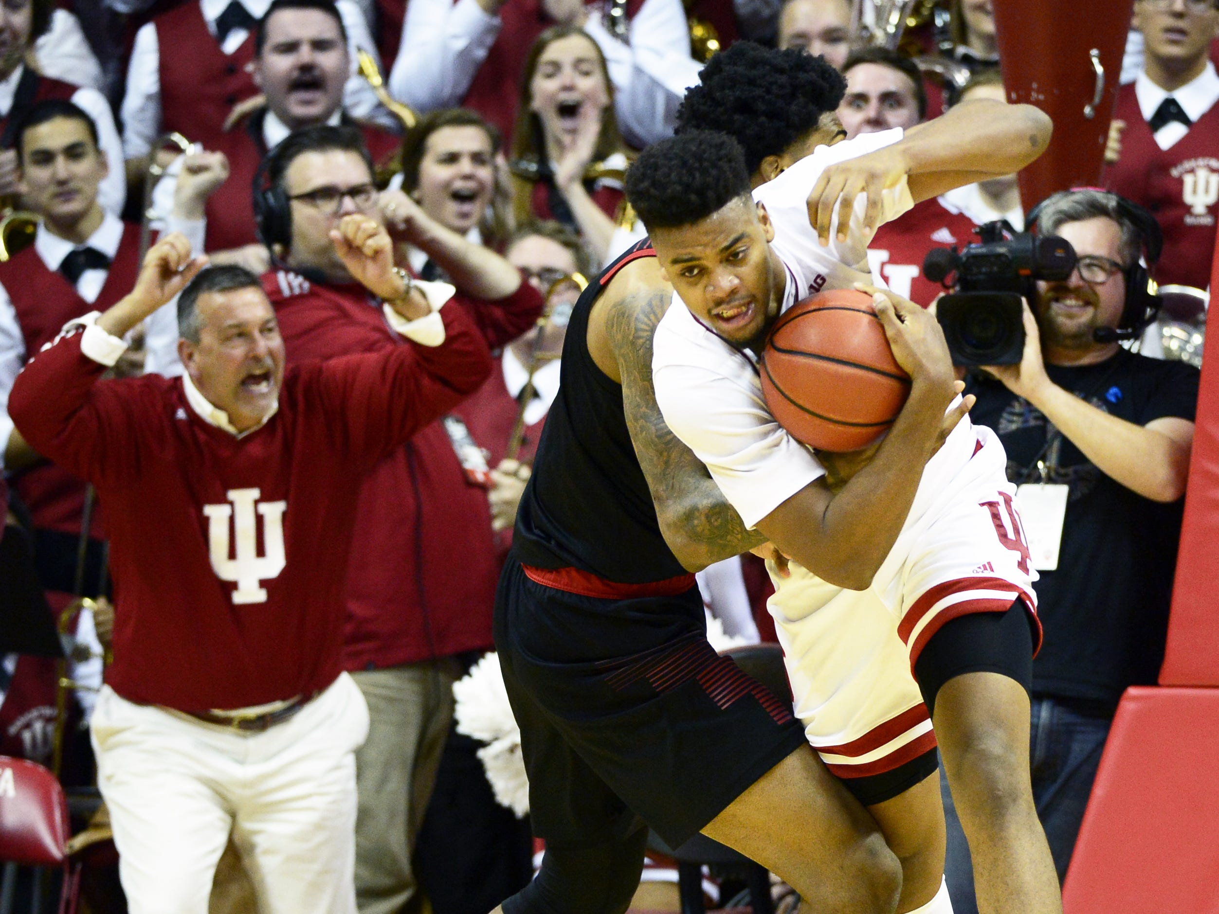 Indiana Hoosiers forward Juwan Morgan (13) is fouled at the end of the game against Louisville at Simon Skjodt Assembly Hall in Bloomington, Ind.