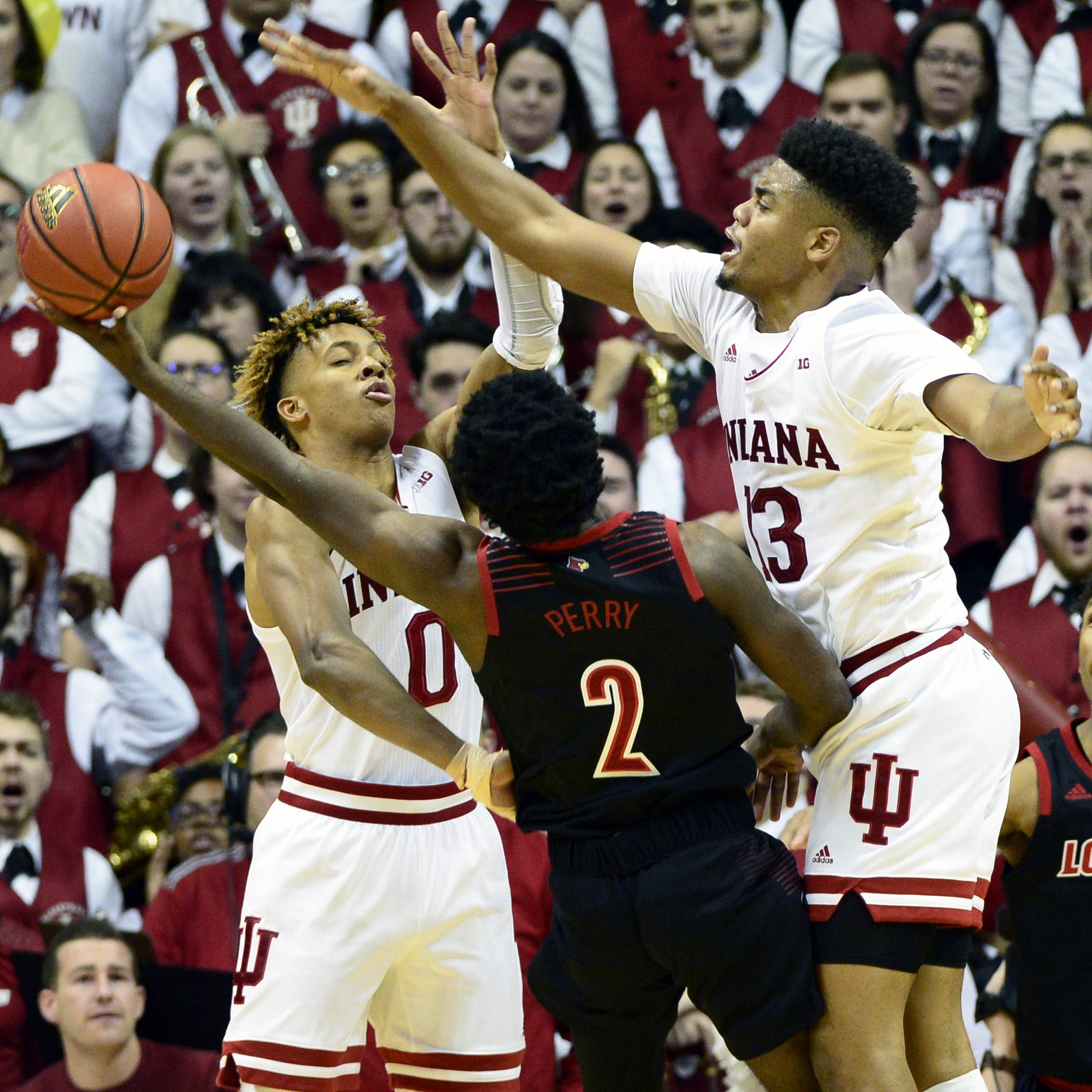 Indiana Hoosiers guard Romeo Langford (0) and...