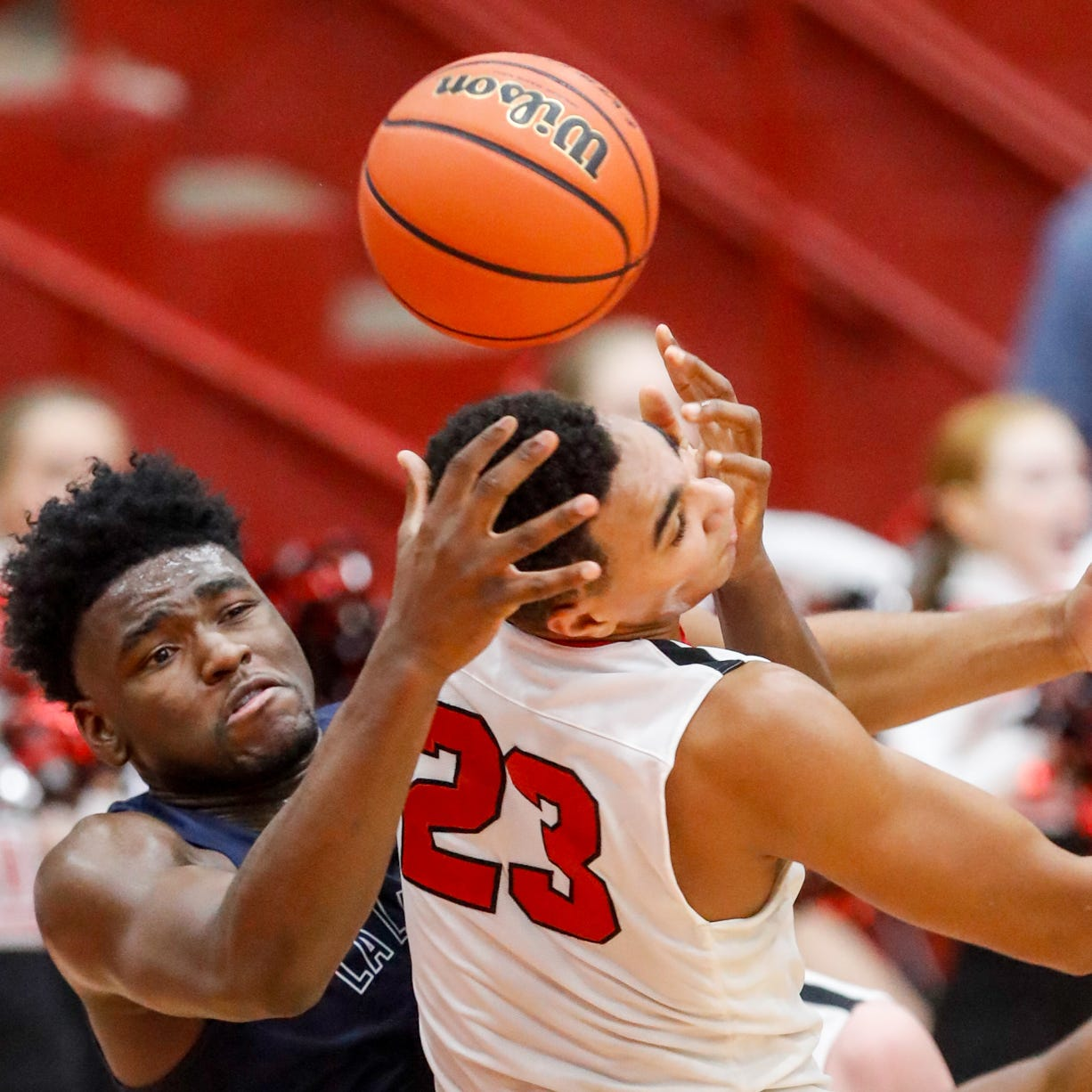 La Lumiere's Isaiah Stewart tangles with Center Grove's Trayce Jackson-Davis (23) over a rebound  during a Tip Off Classic game Saturday at the Southport Fieldhouse.