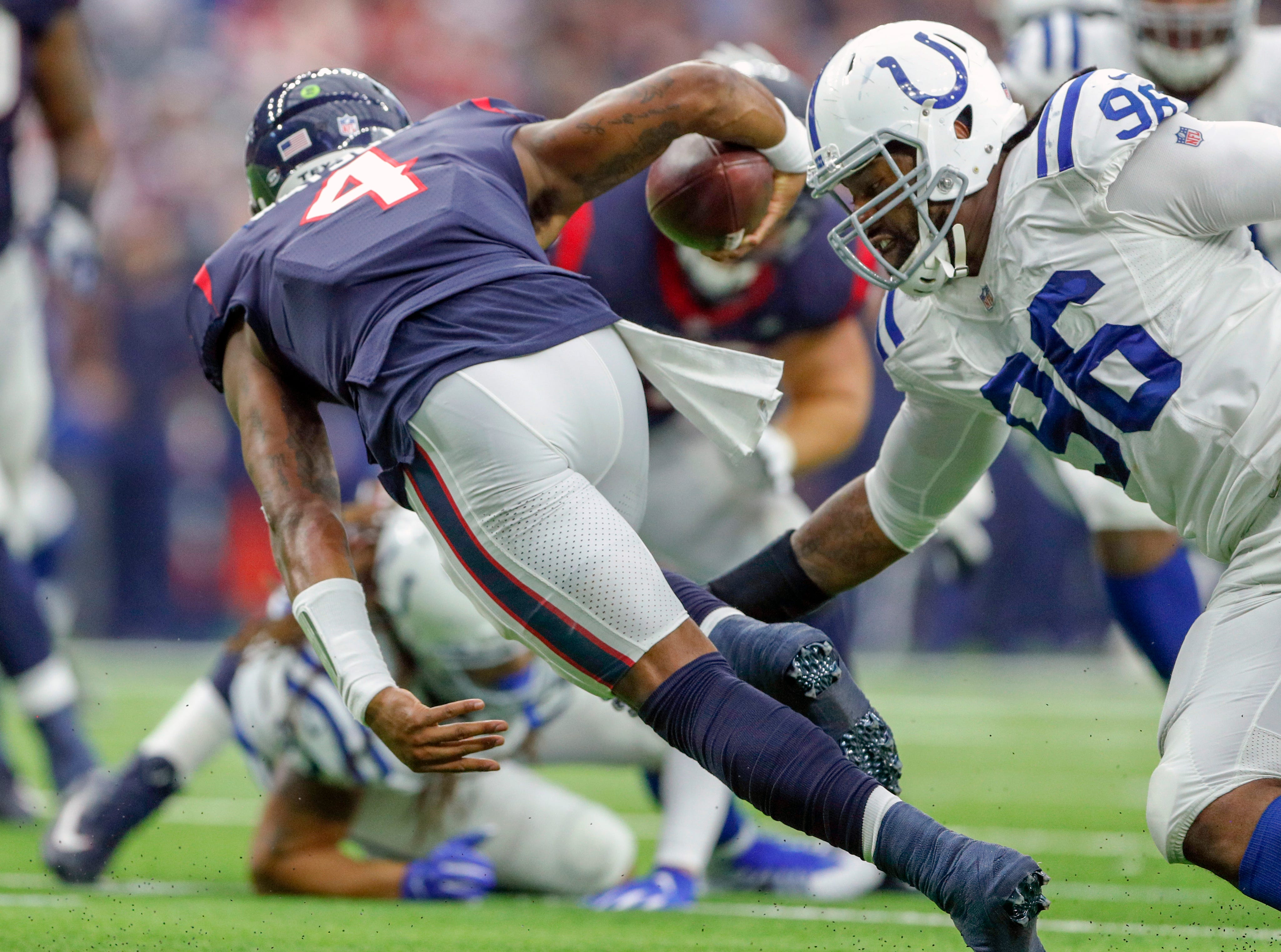 Indianapolis Colts defensive tackle Denico Autry (96) sakcs Houston Texans quarterback Deshaun Watson (4) at NRG Stadium in Houston on Sunday, Dec. 9, 2018.