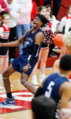 La Lumiere's Keion Brooks Jr. (12) celebrates a dunk during a Tip Off Classic game against Center Grove.