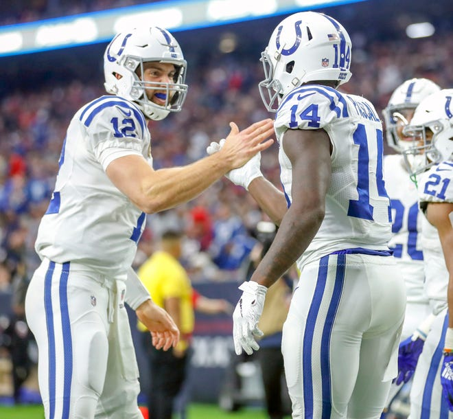 Indianapolis Colts quarterback Andrew Luck (12) celebrates with wide receiver Zach Pascal (14) after a touchdown against the Houston Texans in the third quarter at NRG Stadium in Houston on Sunday, Dec. 9, 2018.