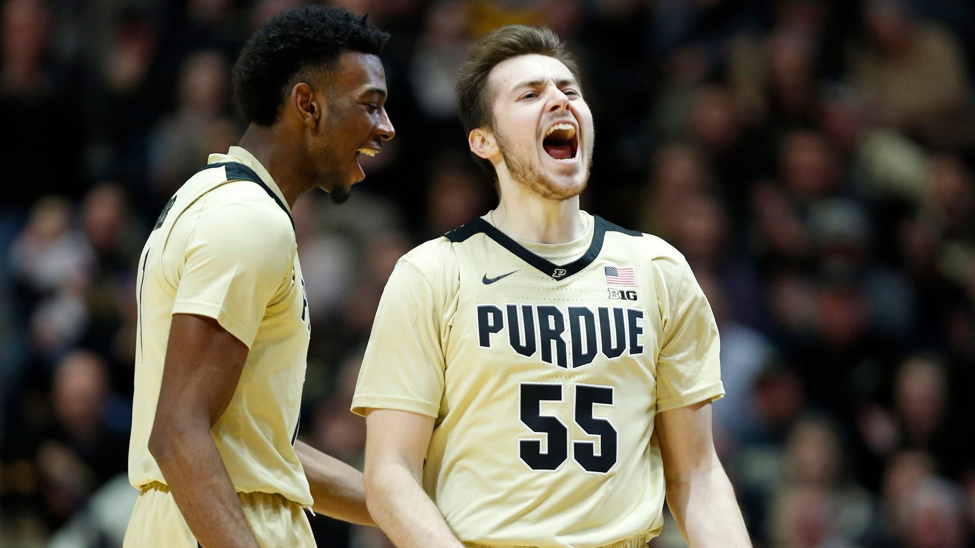 Sasha Stefanovic of Purdue and teammate Aaron Wheeler react after a Maryland turnover with 11:17 remaining Thursday, December 6, 2018, at Mackey Arena. Purdue defeated Maryland 62-60.