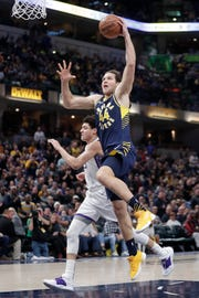Indiana Pacers forward Bojan Bogdanovic (44) goes up for a dunk in front of Sacramento Kings forward Justin Jackson (25) during the second half of their game Saturday.
