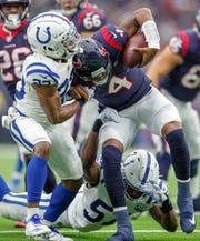Indianapolis Colts cornerback Kenny Moore (23) sacks Houston Texans quarterback Deshaun Watson (4) at NRG Stadium in Houston on Sunday, Dec. 9, 2018.
