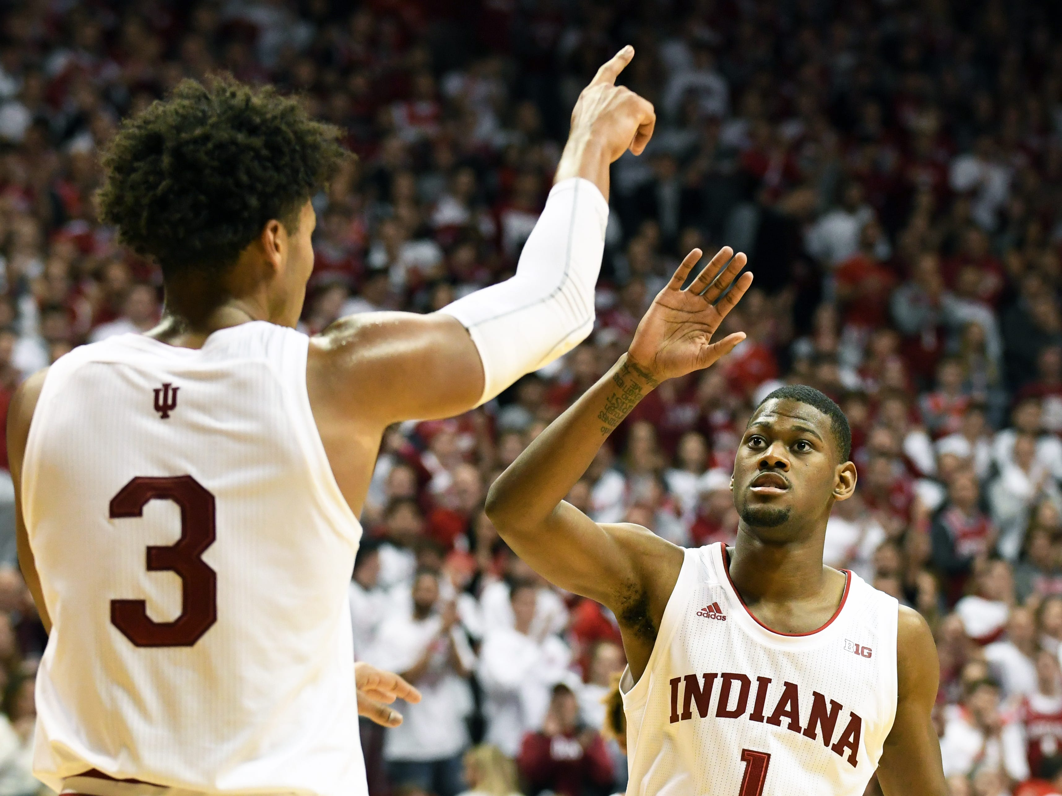 Indiana Hoosiers forward Justin Smith (3) and Indiana Hoosiers guard Al Durham (1) celebrate after a play during the game against Louisville at Simon Skjodt Assembly Hall in Bloomington, Ind.