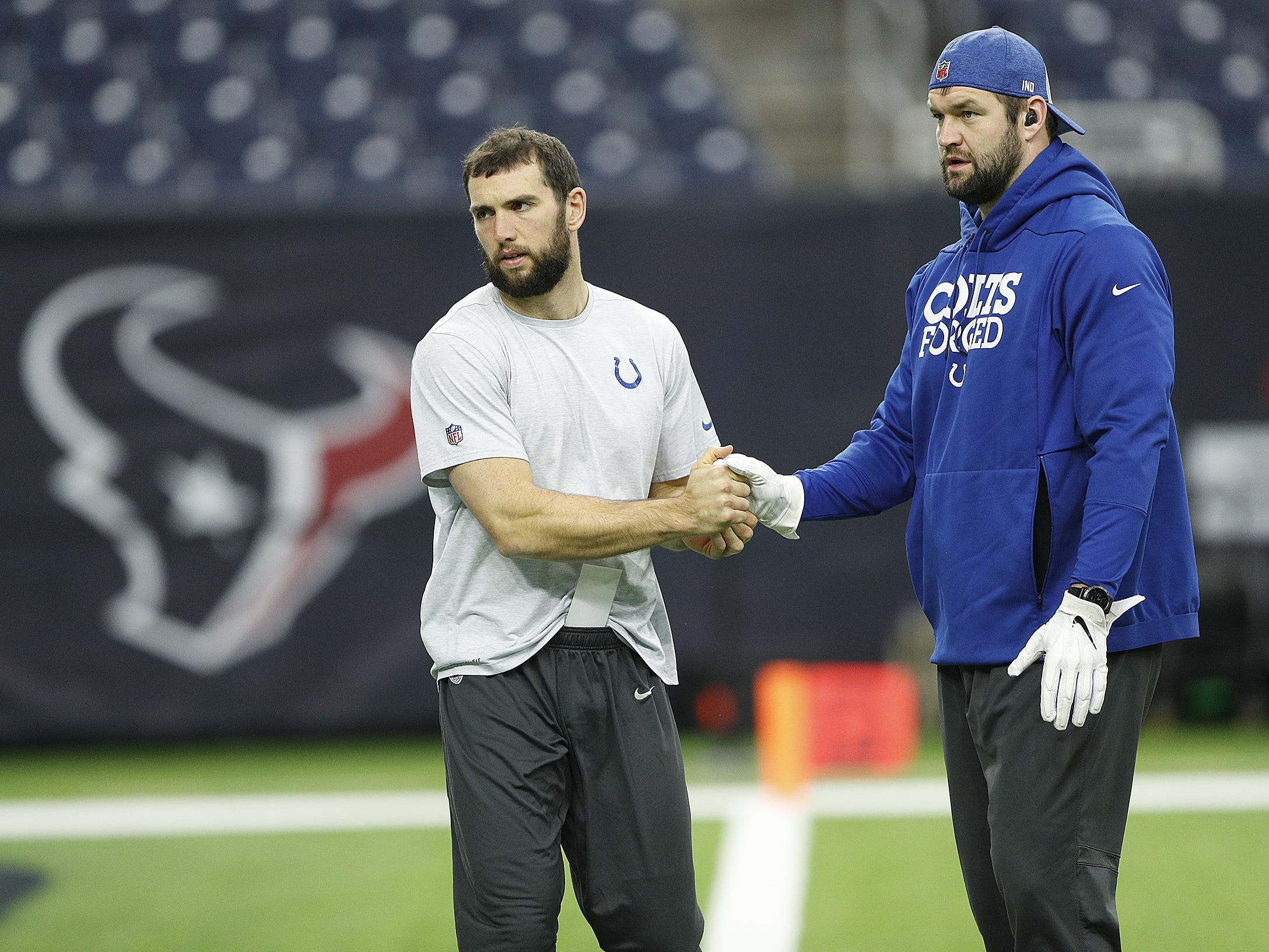 Indianapolis Colts quarterback Andrew Luck (12) and defensive end Margus Hunt (92) before the start of their game against the Houston Texans at NRG Stadium in Houston, TX., on Sunday, Dec. 9, 2018.