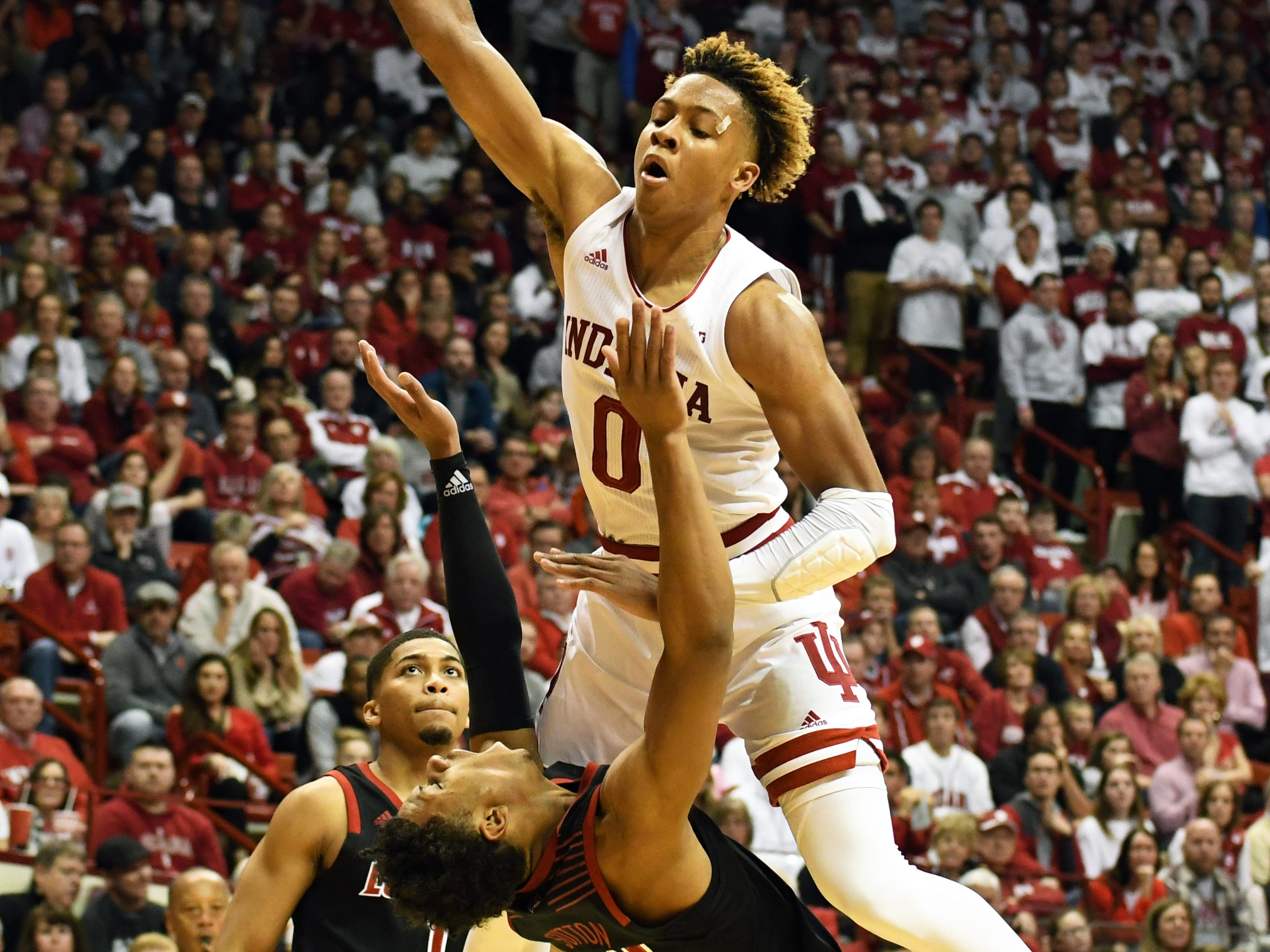 Indiana Hoosiers guard Romeo Langford (0) is called for an offensive foul as he goes to the basket during the game against Louisville at Simon Skjodt Assembly Hall in Bloomington, Ind.