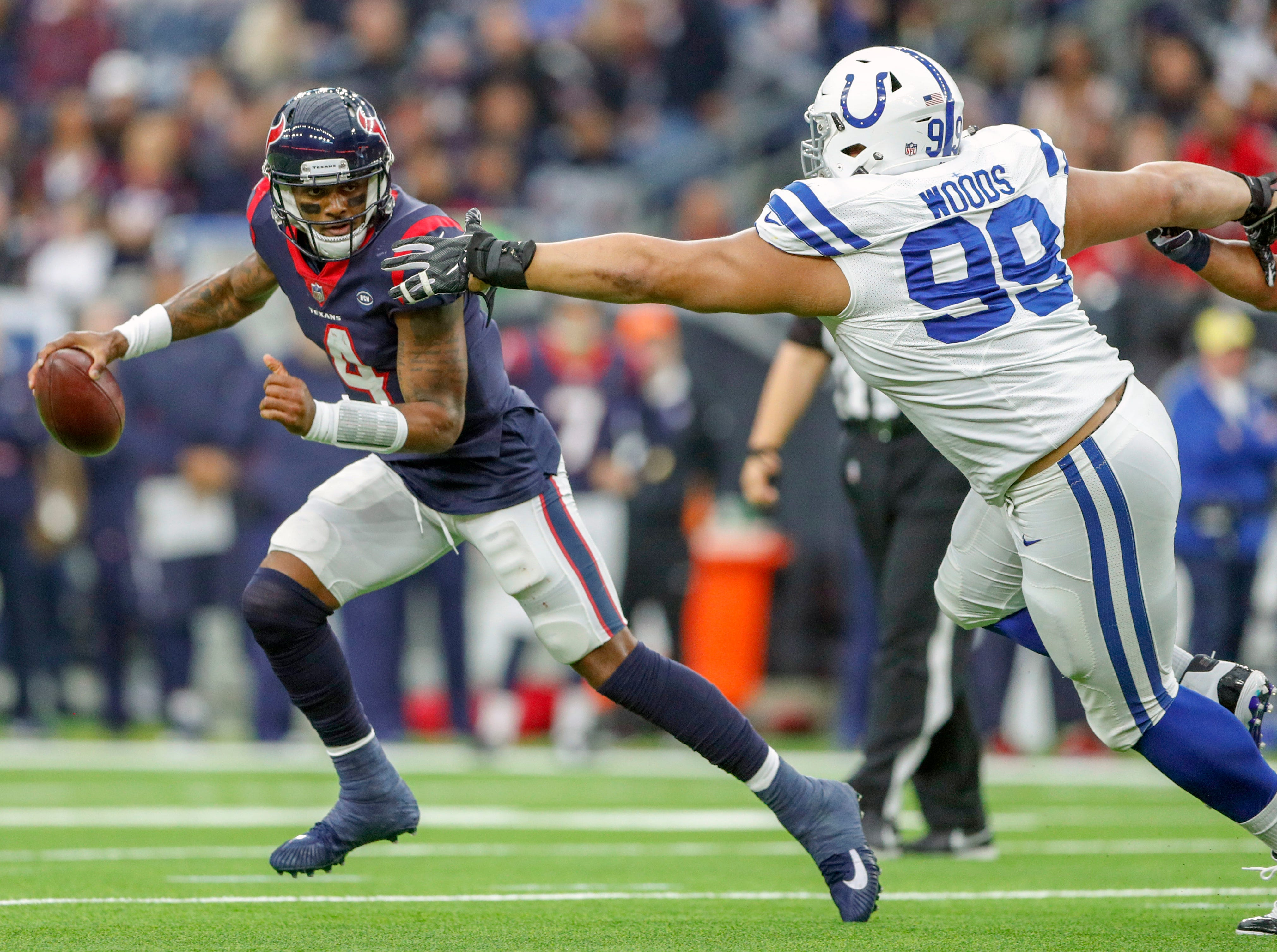 Indianapolis Colts defensive tackle Al Woods (99) pressures Houston Texans quarterback Deshaun Watson (4) in the third quarter at NRG Stadium in Houston on Sunday, Dec. 9, 2018.