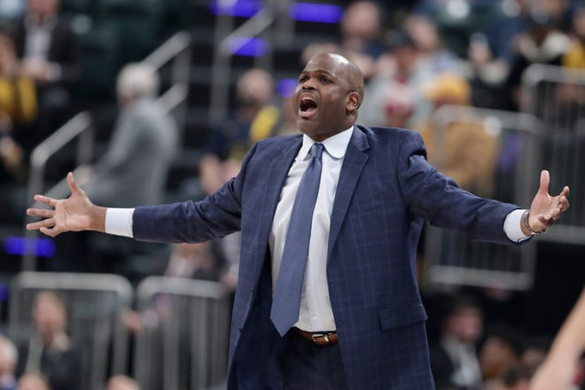 Indiana Pacers head coach Nate McMillan questions a call during the first half of an NBA basketball game against the Sacramento Kings in Indianapolis.