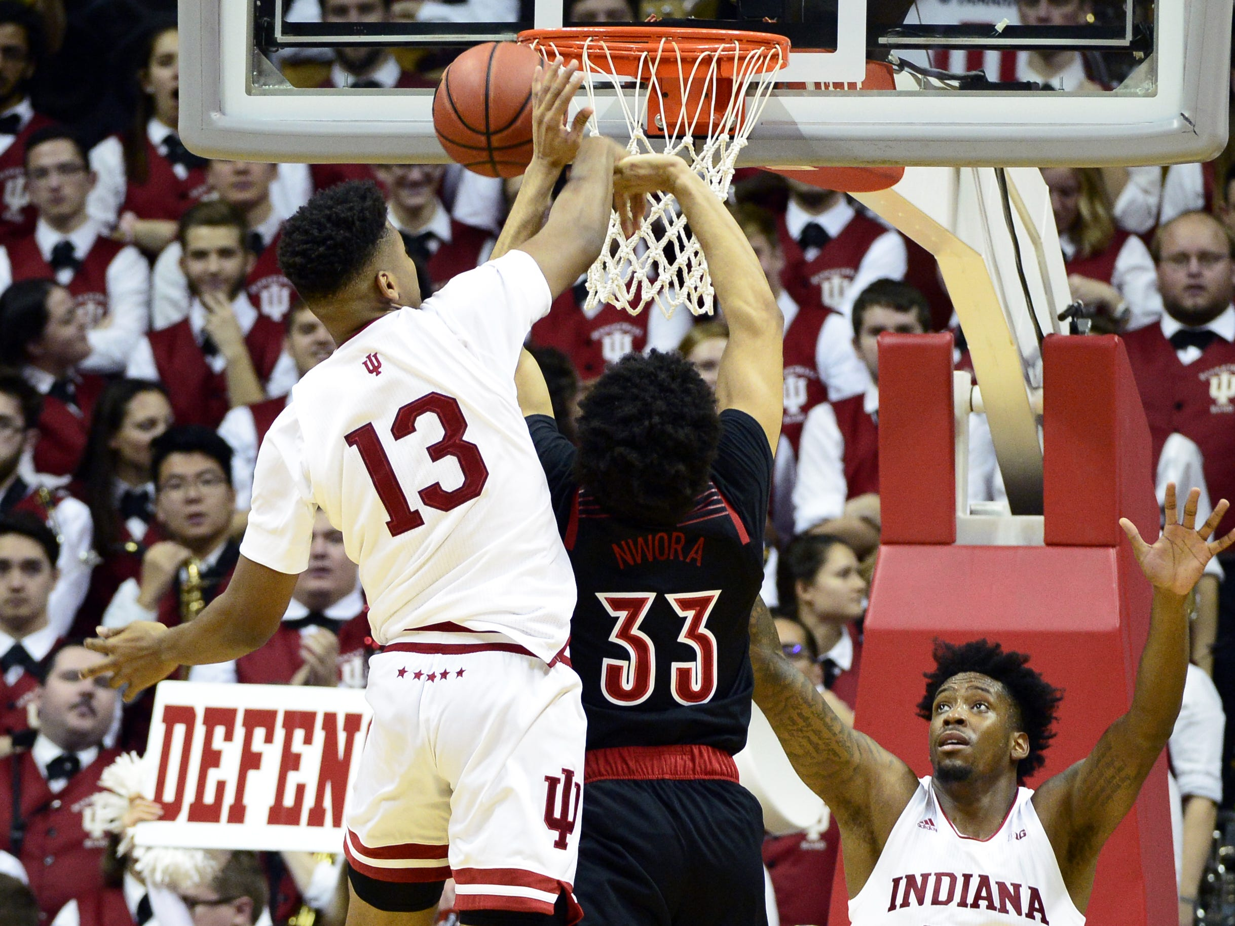 Indiana Hoosiers forward Juwan Morgan (13) blocks a shot from Louisville Cardinals forward Jordan Nwora (33) during the game against Louisville at Simon Skjodt Assembly Hall in Bloomington, Ind., on Saturday, Dec. 8, 2018.