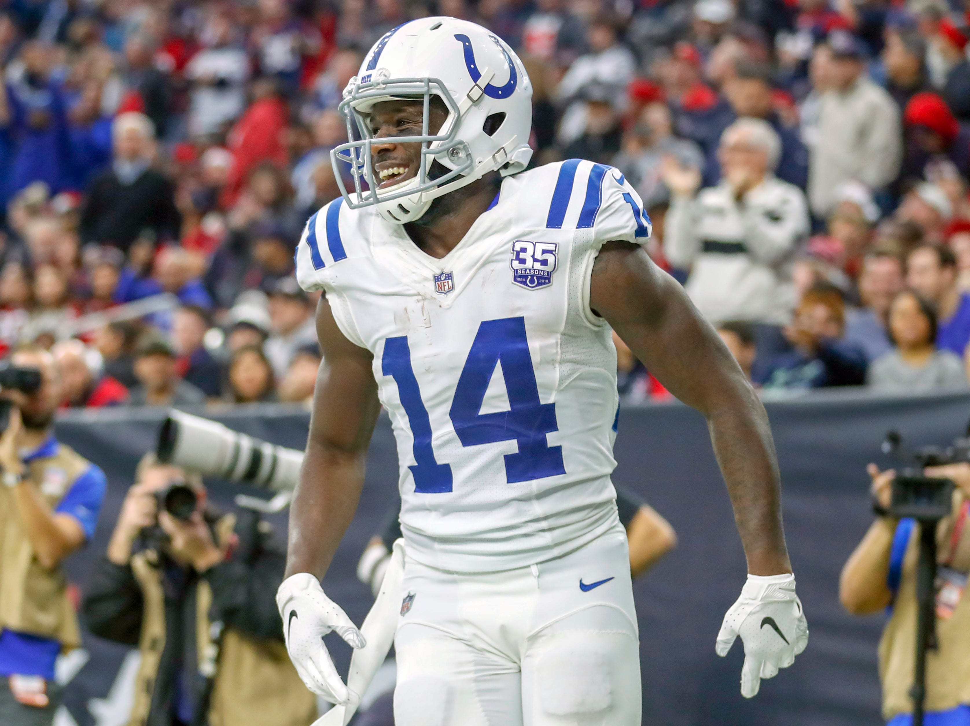 Indianapolis Colts wide receiver Zach Pascal (14) smiles in the end zone after beating Houston Texans defensive back Shareece Wright (43) on a double move and pulling in a touchdown pass in the third quarter at NRG Stadium in Houston on Sunday, Dec. 9, 2018.