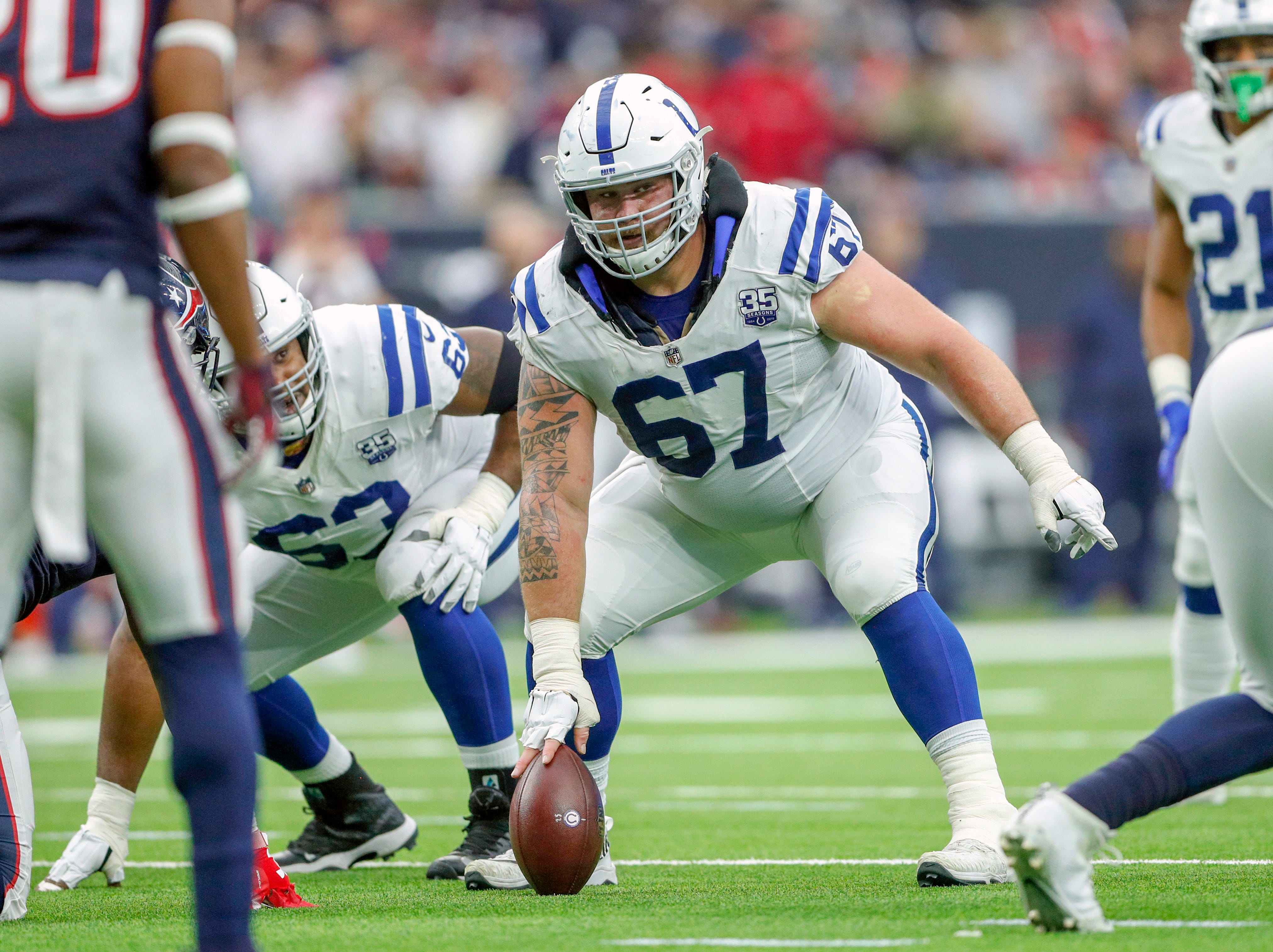 Indianapolis Colts offensive guard Evan Boehm (67) checks  out the defense before the snap against the Houston Texans at NRG Stadium in Houston on Sunday, Dec. 9, 2018.