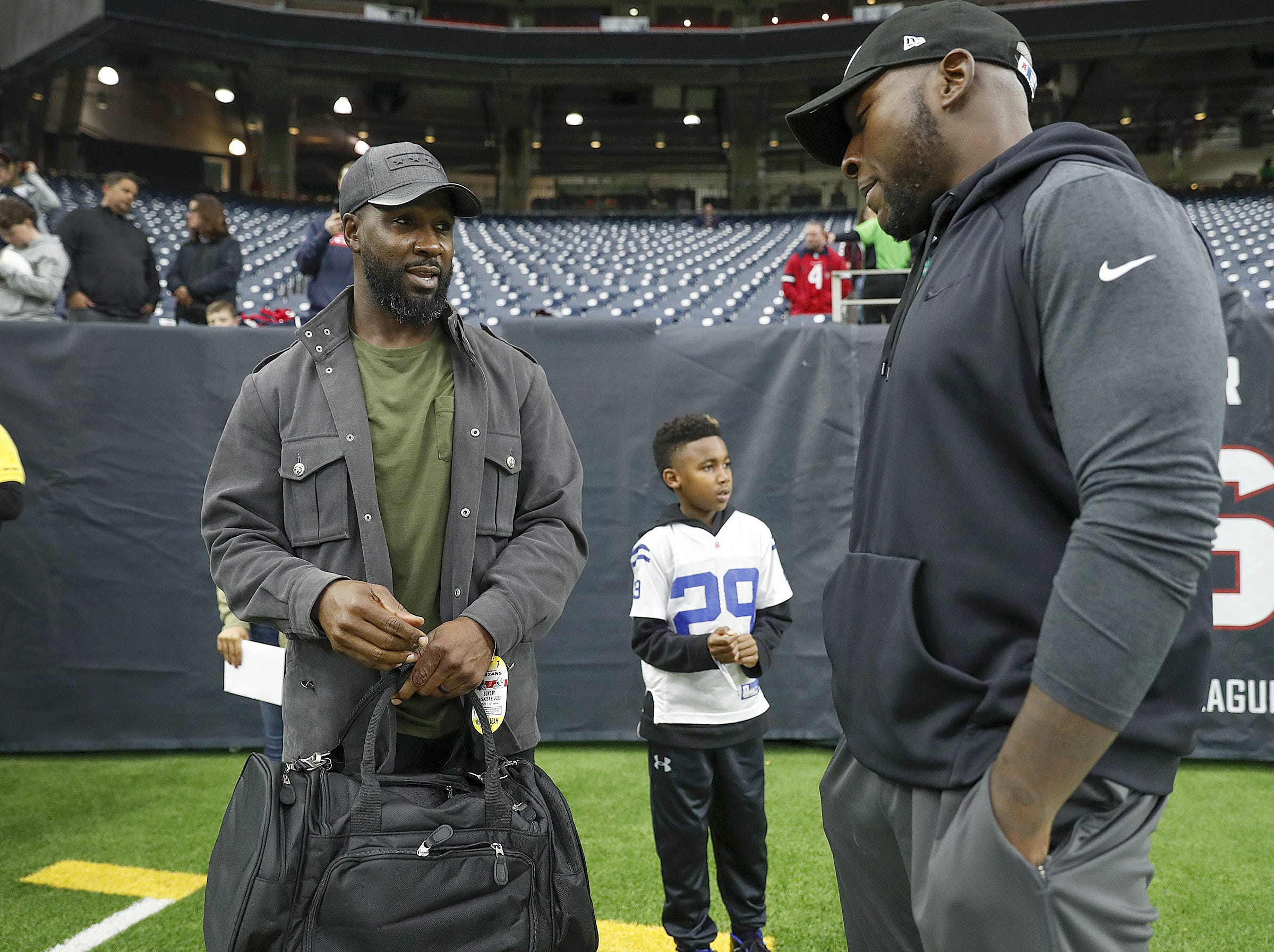 Former Indianapolis Colts running back Joseph Addai talks to his former teammate Robert Mathis, right, before the start of their game against the Houston Texans at NRG Stadium in Houston, TX., on Sunday, Dec. 9, 2018.