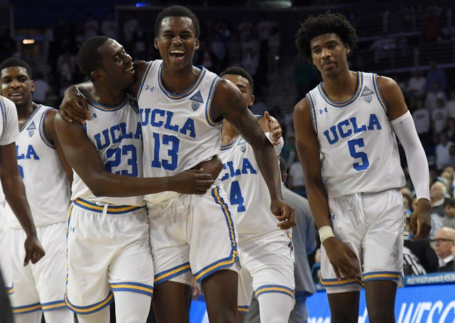 Dec 8, 2018; Los Angeles, CA, USA; UCLA Bruins guard Kris Wilkes (13) celebrates with guard Prince Ali (23) and guard Chris Smith (5) after making a three-point basket for the winning points with 0.9 seconds to play against the Notre Dame Fighting Irish at Pauley Pavilion. UCLA defeated Notre Dame 65-62.