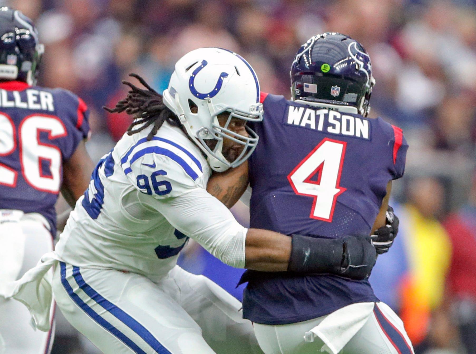 Indianapolis Colts defensive tackle Denico Autry (96) sacks Houston Texans quarterback Deshaun Watson (4) at NRG Stadium in Houston on Sunday, Dec. 9, 2018.