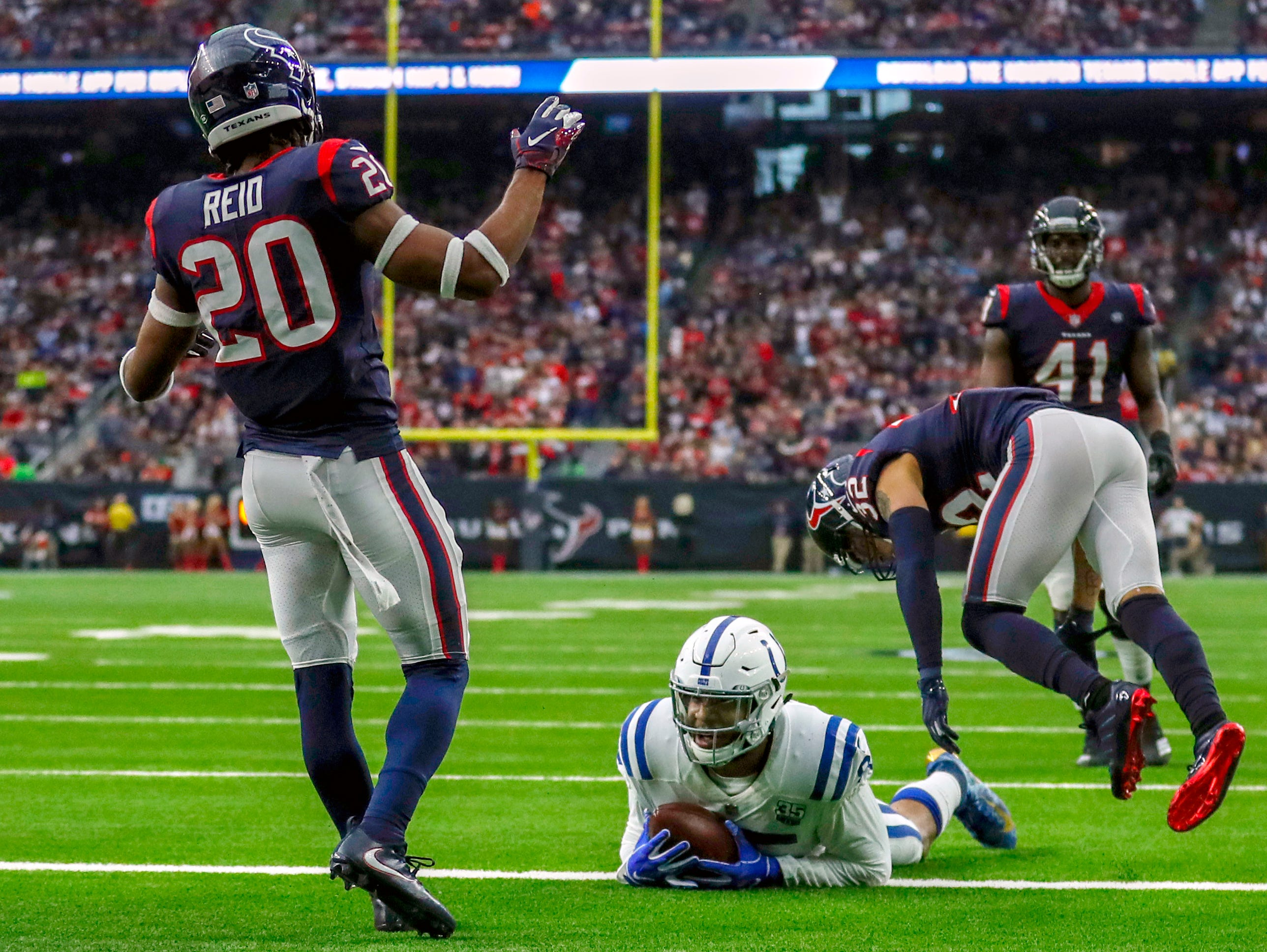 Indianapolis Colts tight end Eric Ebron (85) rolls into the end zone after a pass from Colts quarterback Andrew Luck (12) against the Houston Texans at NRG Stadium in Houston on Sunday, Dec. 9, 2018.