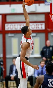 Center Grove's Trayce Jackson-Davis (23)  dunks during the game Saturday.