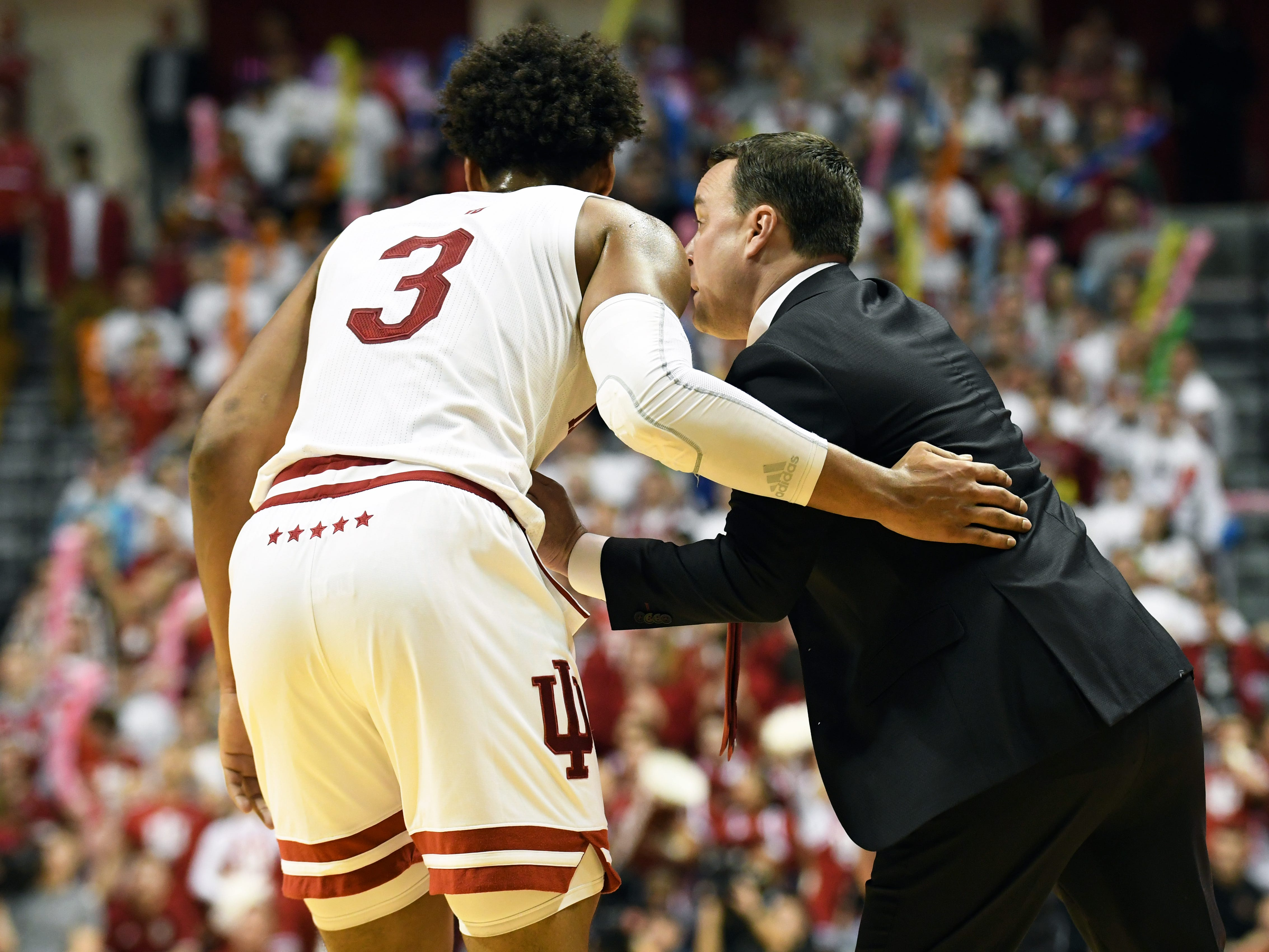 Indiana Hoosiers forward Justin Smith (3) talks to Indiana Hoosiers head coach Archie Miller during the game against Louisville at Simon Skjodt Assembly Hall in Bloomington, Ind.