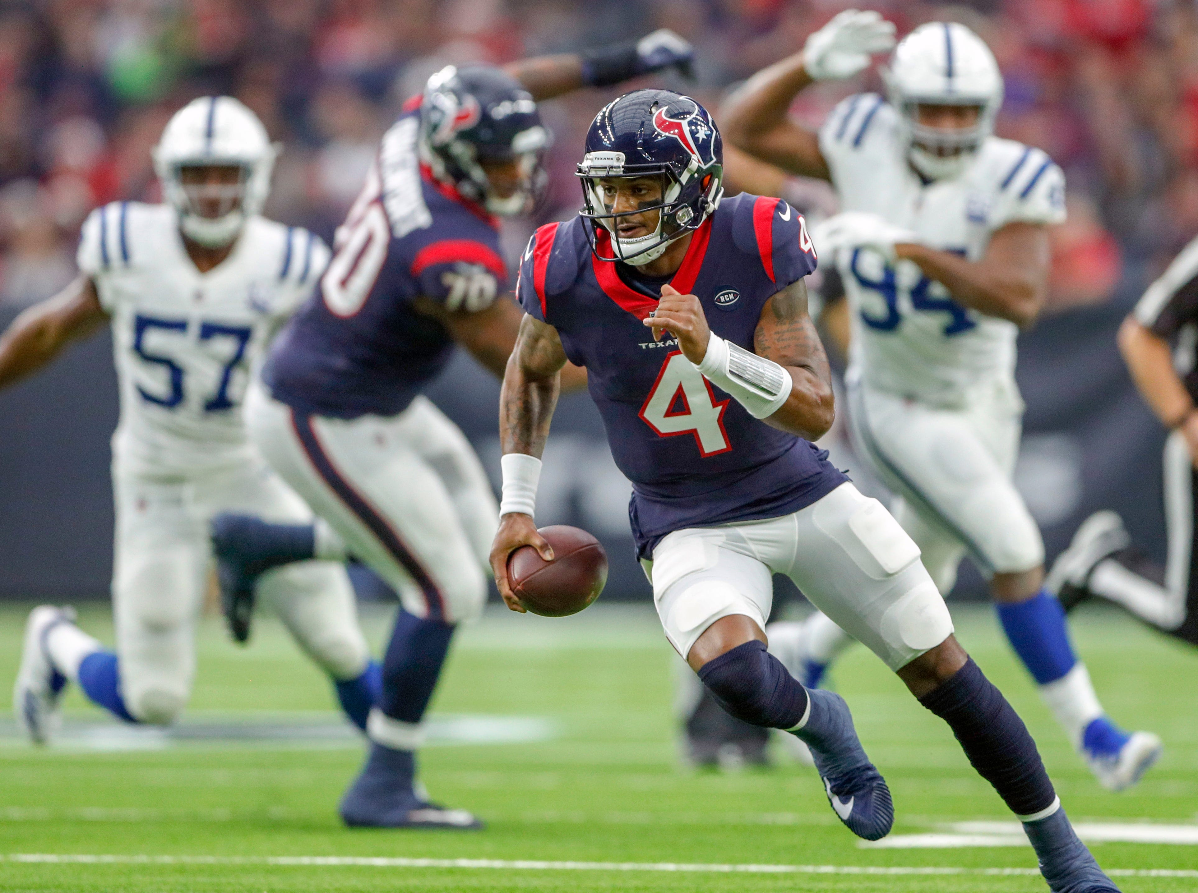 Houston Texans quarterback Deshaun Watson (4) scrambles against the Indianapolis Colts at NRG Stadium in Houston on Sunday, Dec. 9, 2018.