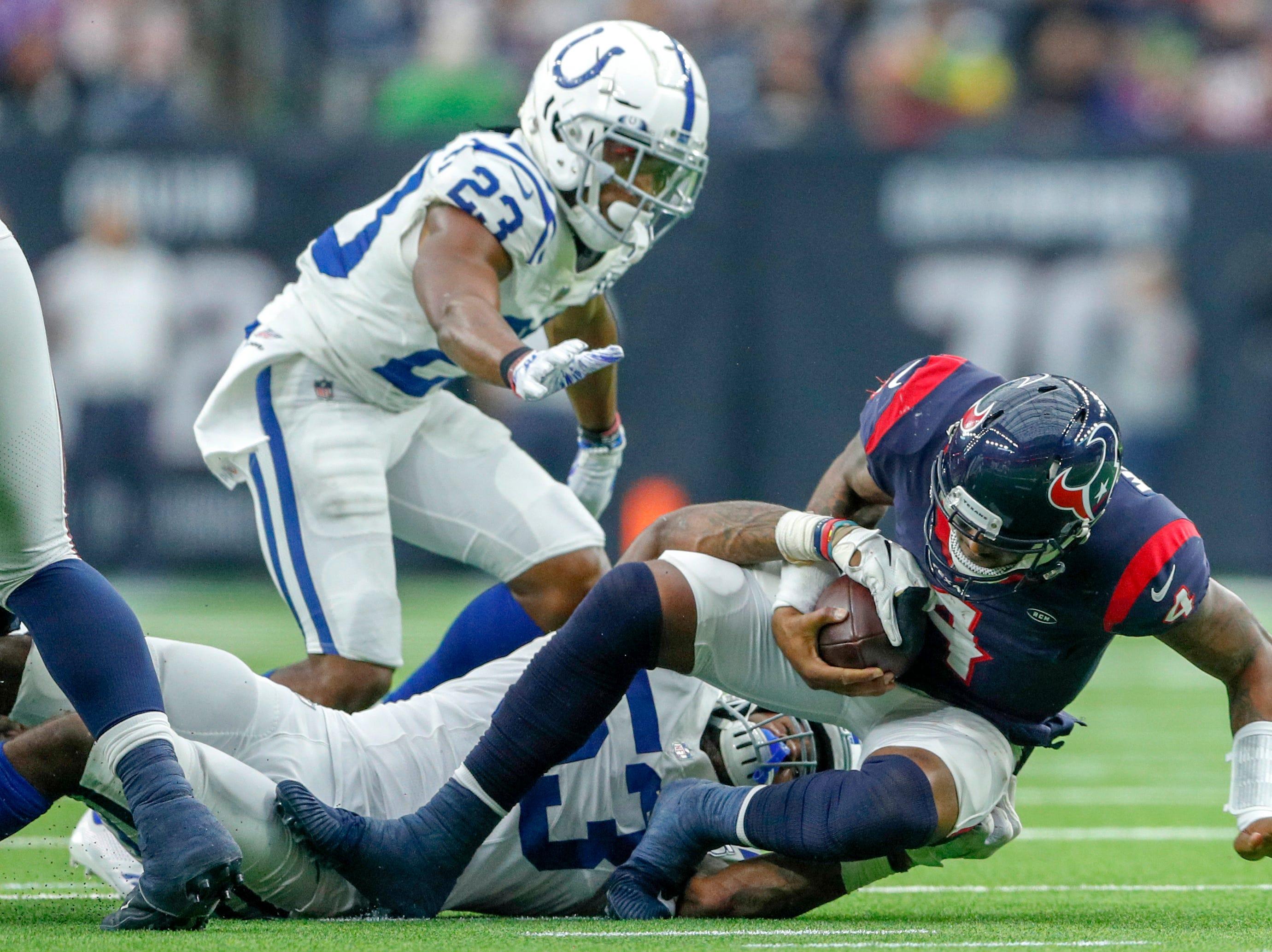Indianapolis Colts outside linebacker Darius Leonard (53) brings down Houston Texans quarterback Deshaun Watson (4) in the third quarter at NRG Stadium in Houston on Sunday, Dec. 9, 2018.