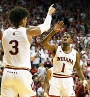 Indiana Hoosiers forward Justin Smith (3) and Indiana Hoosiers guard Al Durham (1) celebrate after a play during the game against Louisville at Simon Skjodt Assembly Hall in Bloomington, Ind., on Saturday, Dec. 8, 2018.