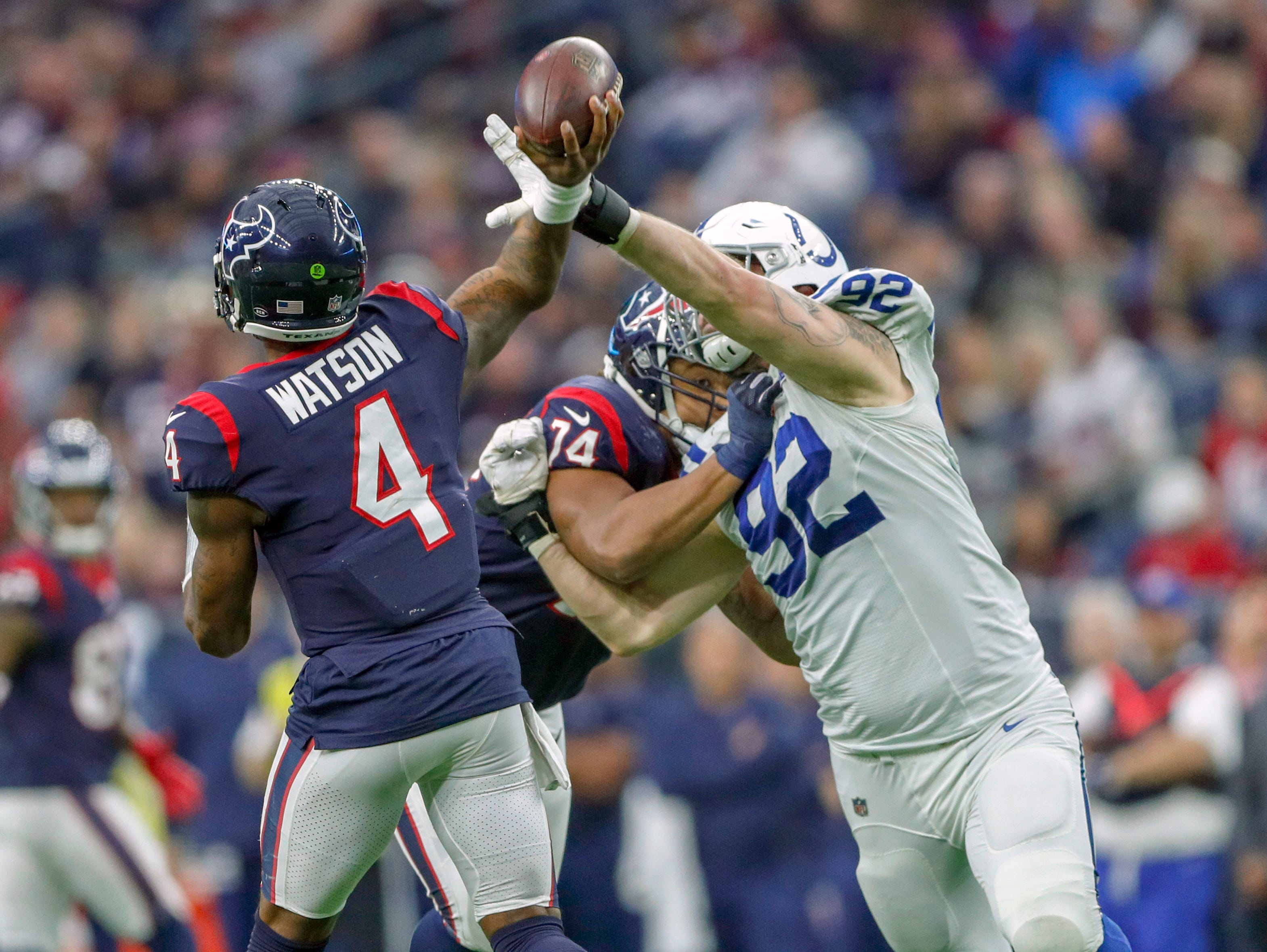 Indianapolis Colts defensive end Margus Hunt (92) breaks up a pass attempt by Houston Texans quarterback Deshaun Watson (4) in the fourth quarter at NRG Stadium in Houston on Sunday, Dec. 9, 2018.
