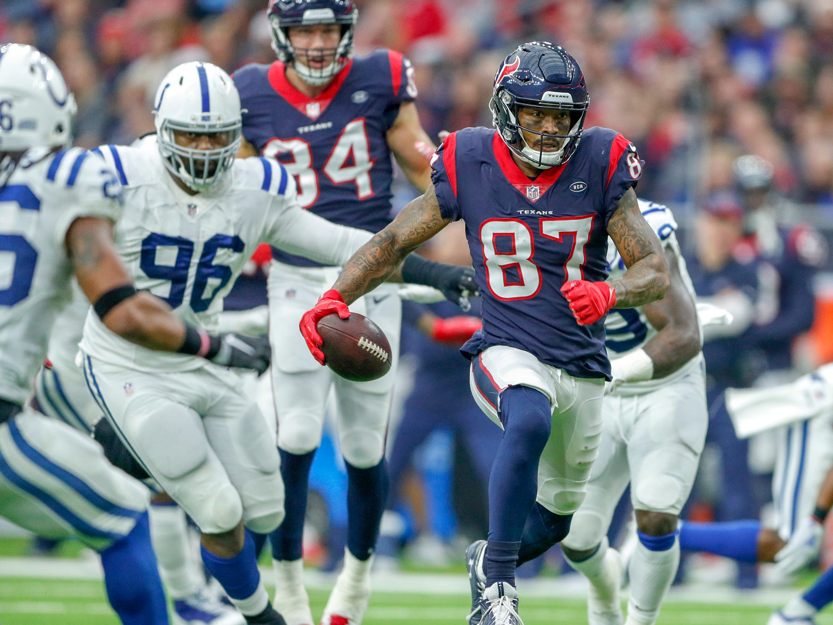 Houston Texans wide receiver Demaryius Thomas (87) takes a pass downfield against the Indianapolis Colts defense in the third quarter at NRG Stadium in Houston on Sunday, Dec. 9, 2018.