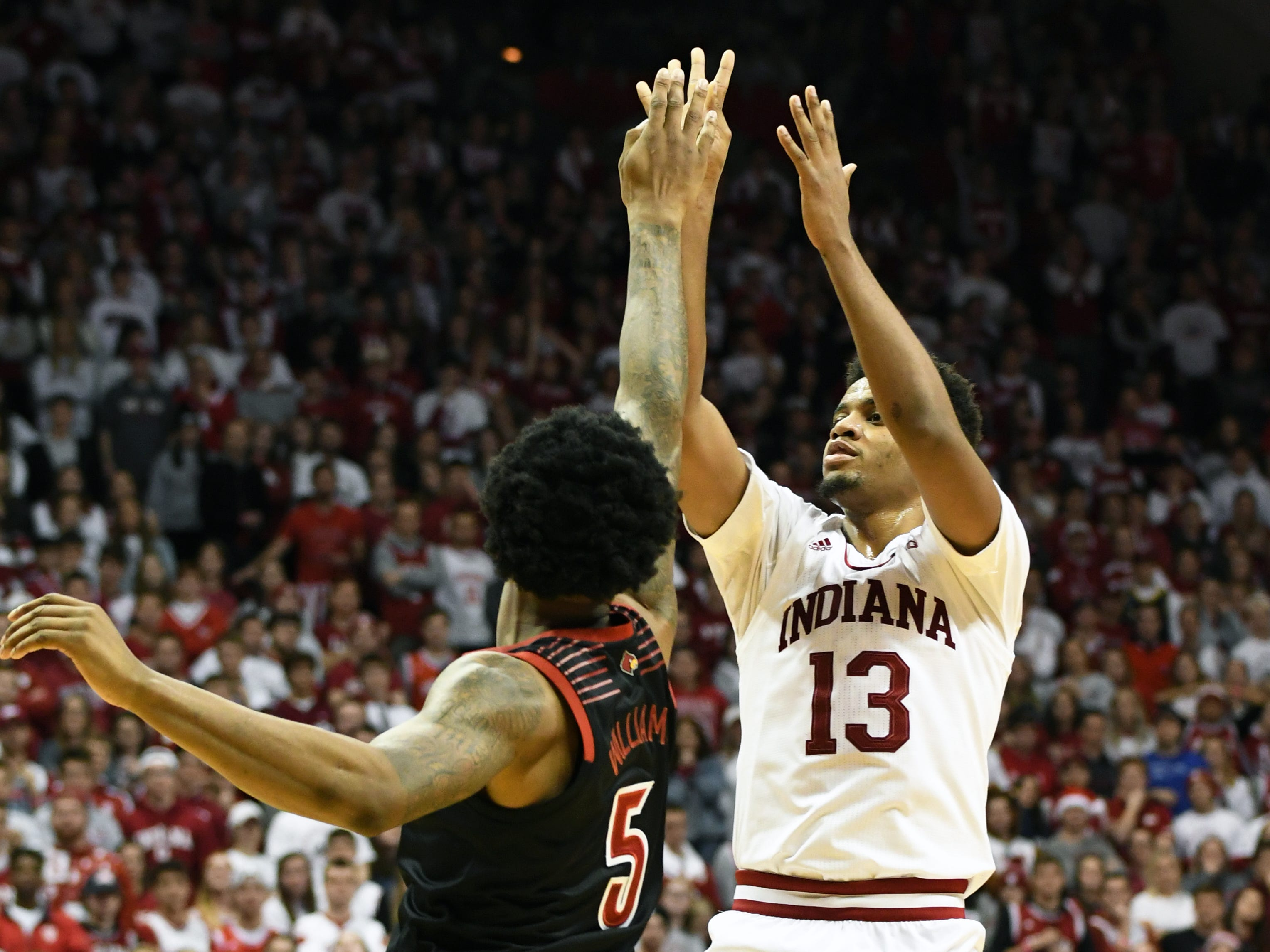Indiana Hoosiers forward Juwan Morgan (13) shoots the ball during the game against Louisville at Simon Skjodt Assembly Hall in Bloomington, Ind.