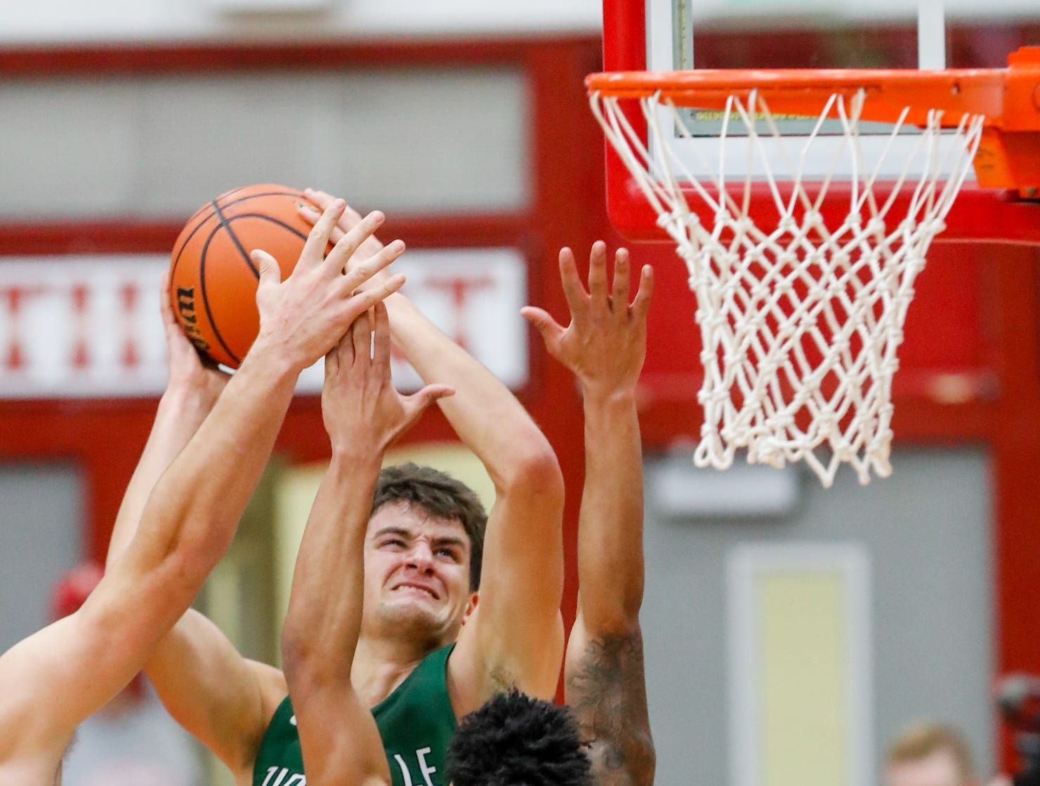 Zionsville Community High School's Nathan Childress (24) and Cathedral High School's guard James Franklin (0) grab for a rebound during a Tip Off Classic game between Cathedral High School and Zionsville Community High School, held at the Southport Fieldhouse, on Saturday, Dec. 8, 2018.