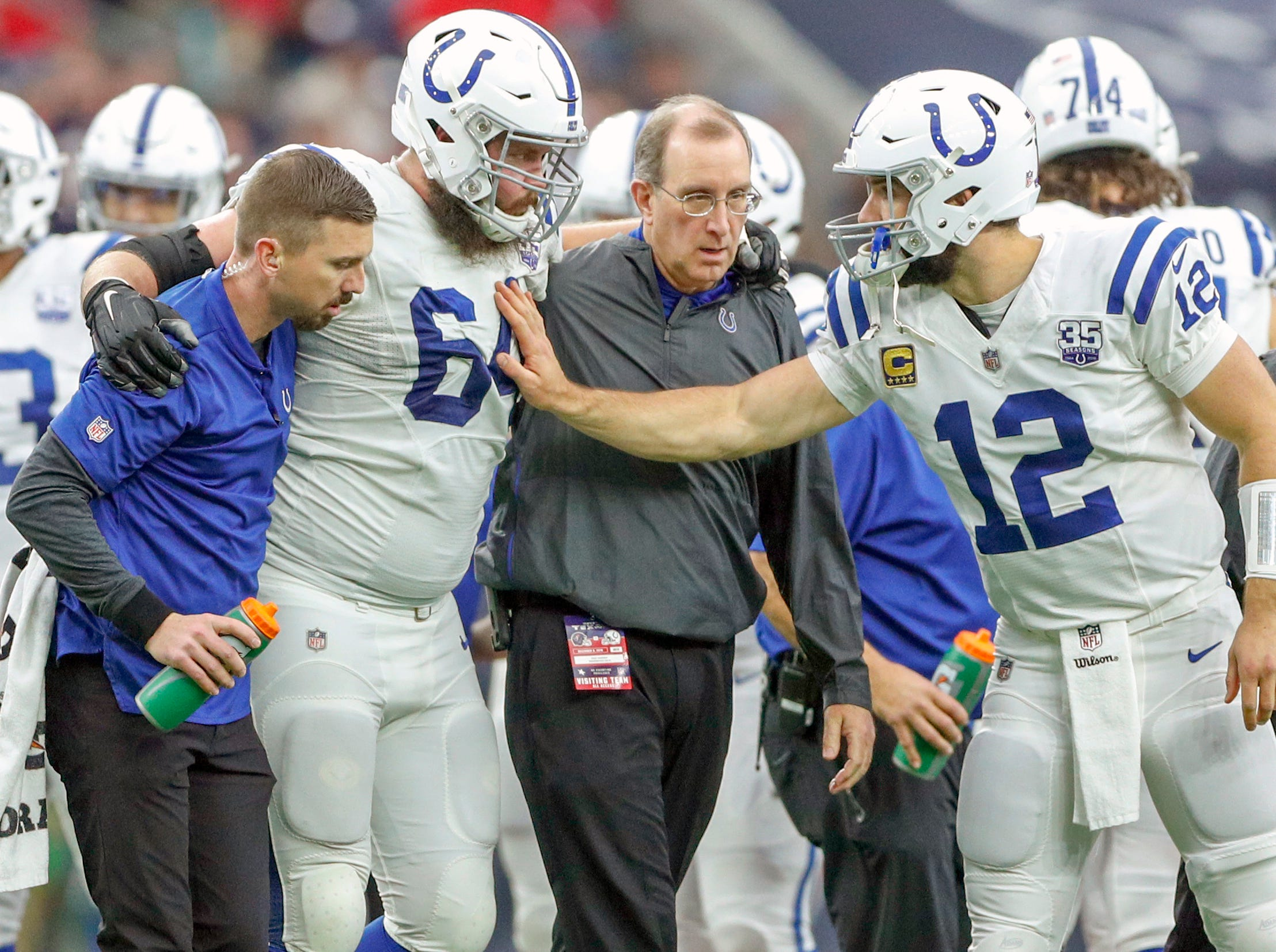 Indianapolis Colts quarterback Andrew Luck (12) checks on an injured Colts offensive guard Mark Glowinski (64) during the game against the Houston Texans at NRG Stadium in Houston on Sunday, Dec. 9, 2018.
