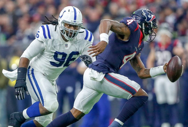 Houston Texans quarterback Deshaun Watson (4) scrambles after Indianapolis Colts defensive tackle Denico Autry (96) brings pressure in the fourth quarter at NRG Stadium in Houston on Sunday, Dec. 9, 2018.